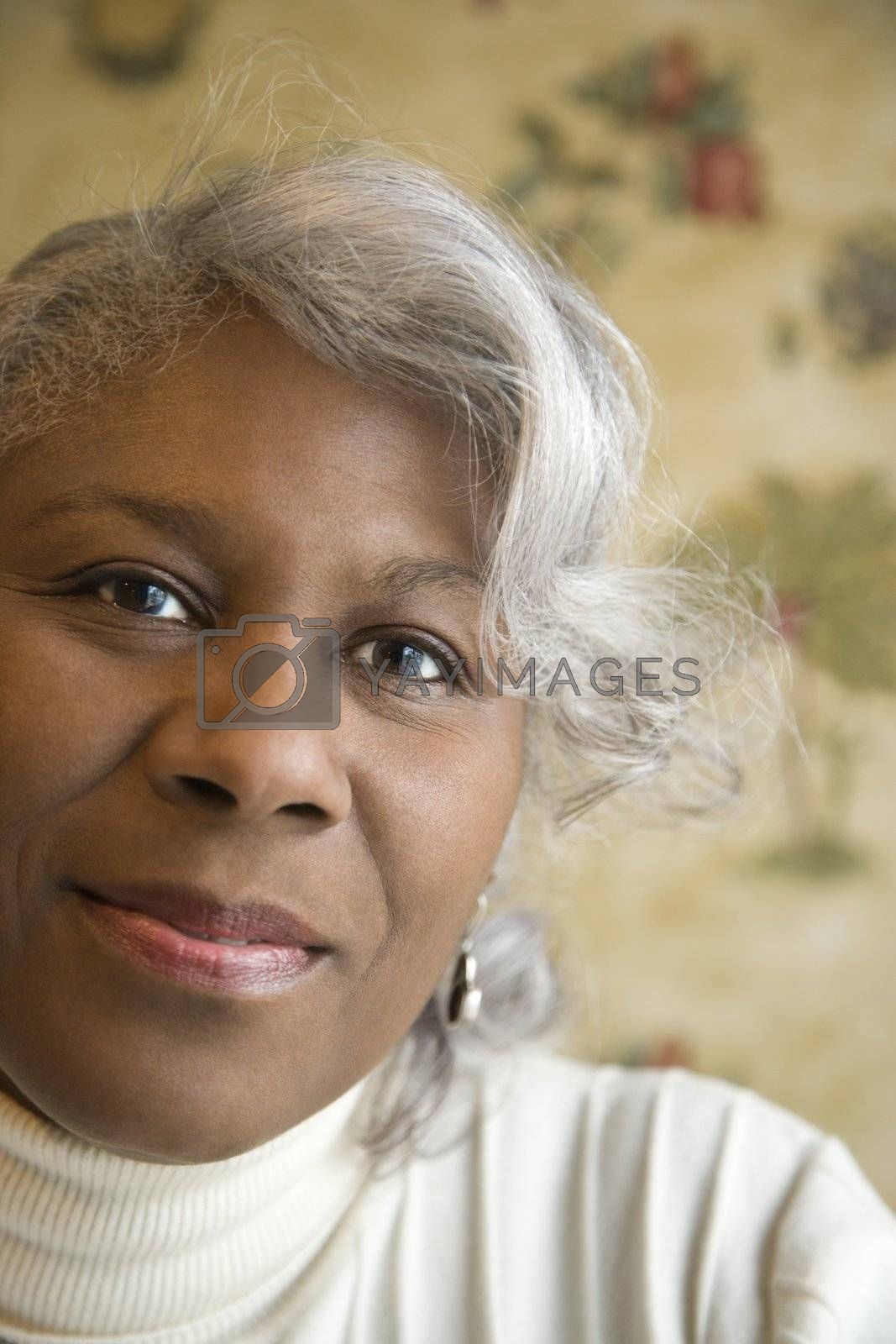 Portrait of mature African American woman looking at the viewer.