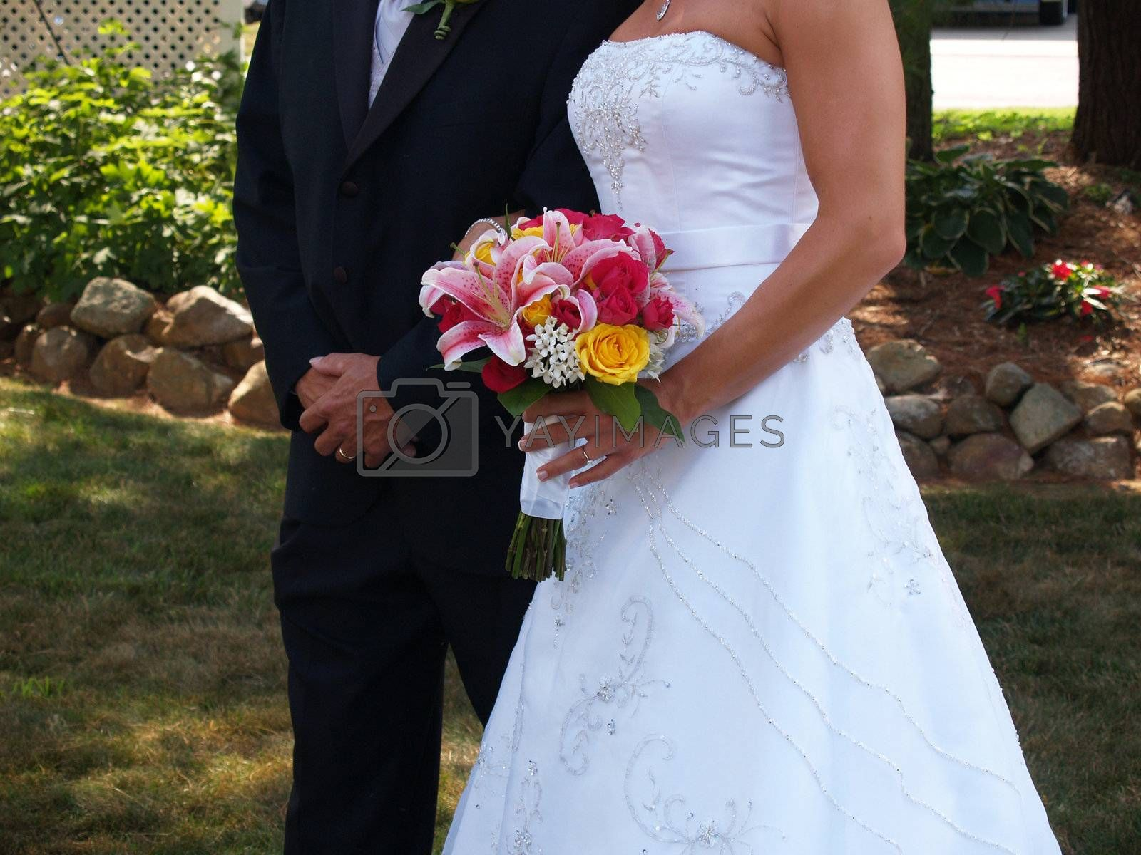 lower body shot of bride and groom