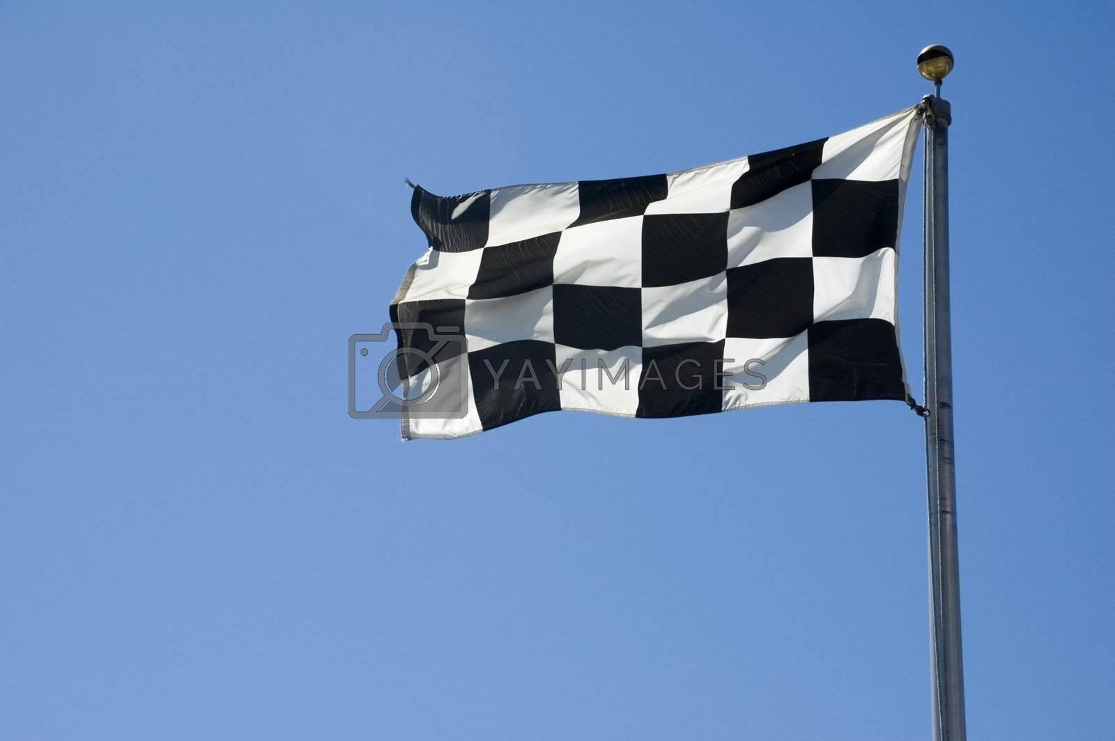 A finish line flag on a pole at a raceway.