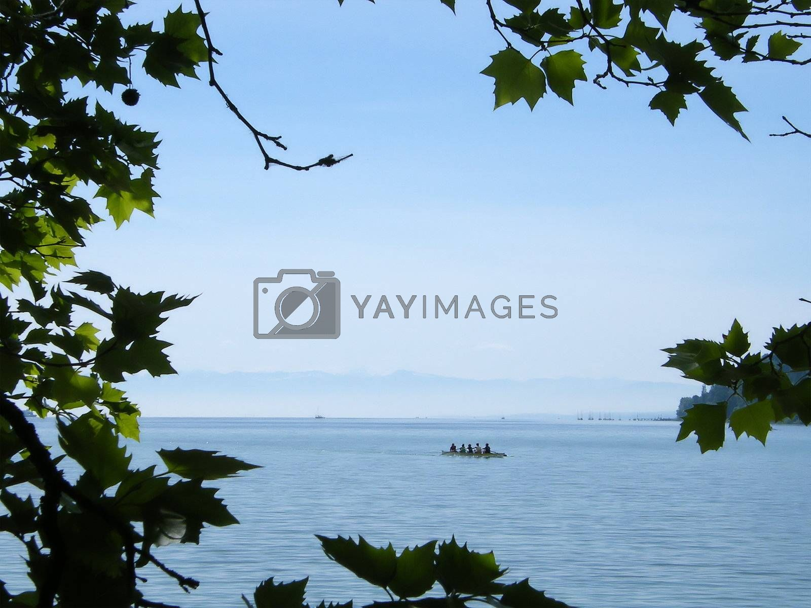 The sea, the mountains, the boat and the ships as a summer background.