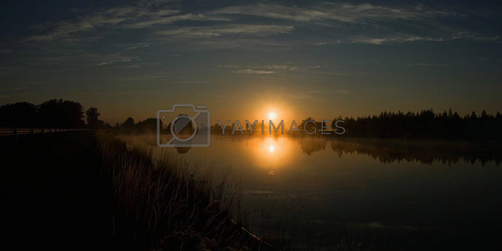 Colorful sunrise on the small lake in Lithuania