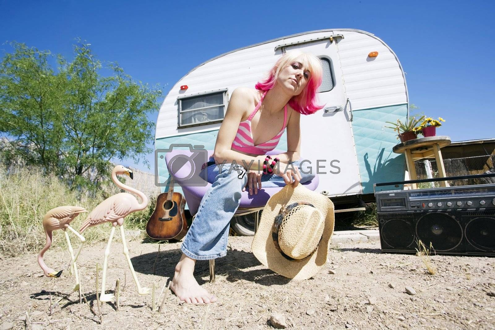Pretty Woman in a Cowboy Hat in Front of a Travel Trailer