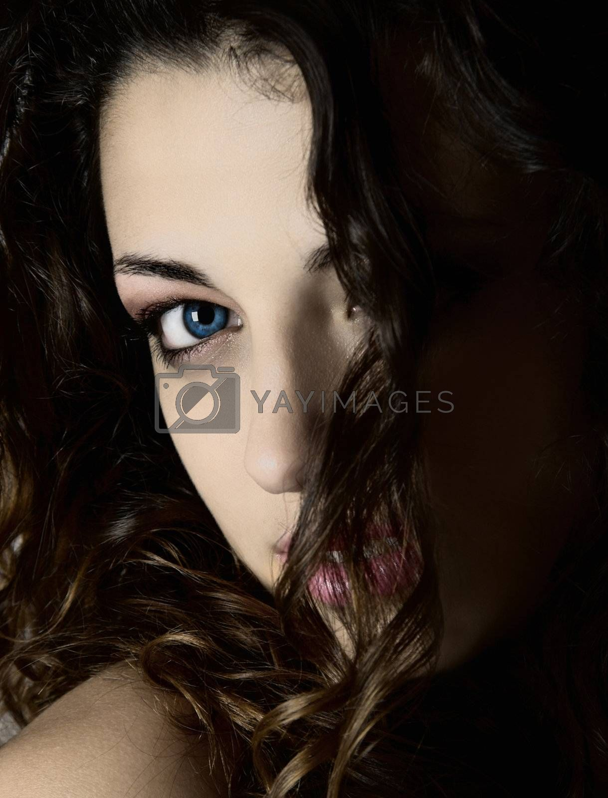 Close-up portrait of a young woman with beautiful blue eyes
