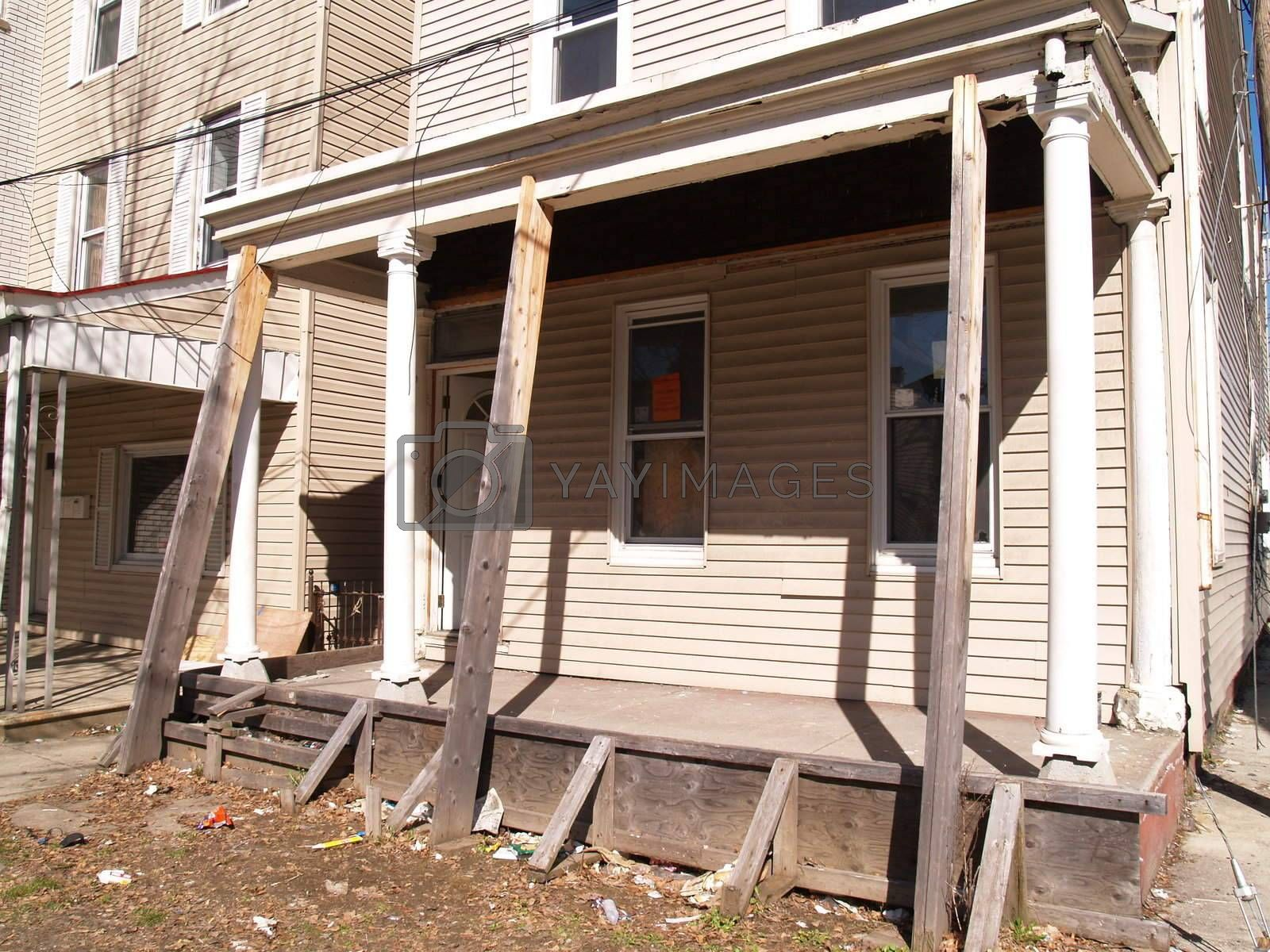 a front porch for an old home that is in need of repair