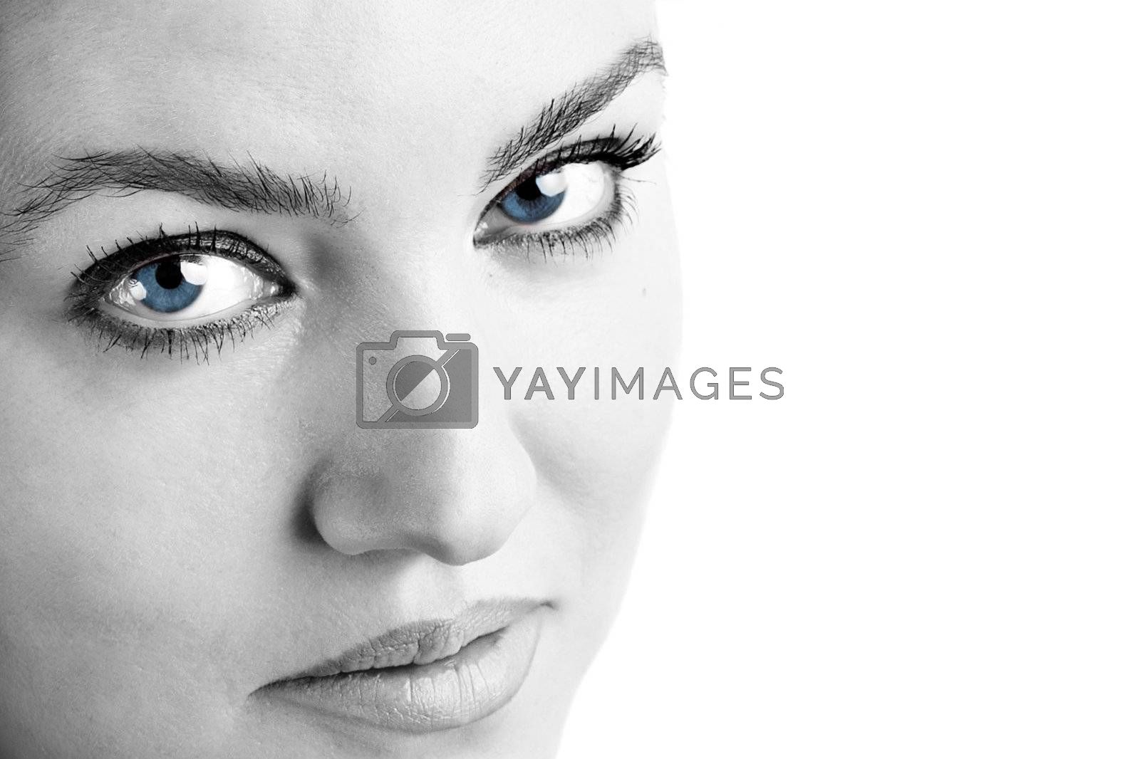 Portrait of a beautiful brunette woman with blue eyes.