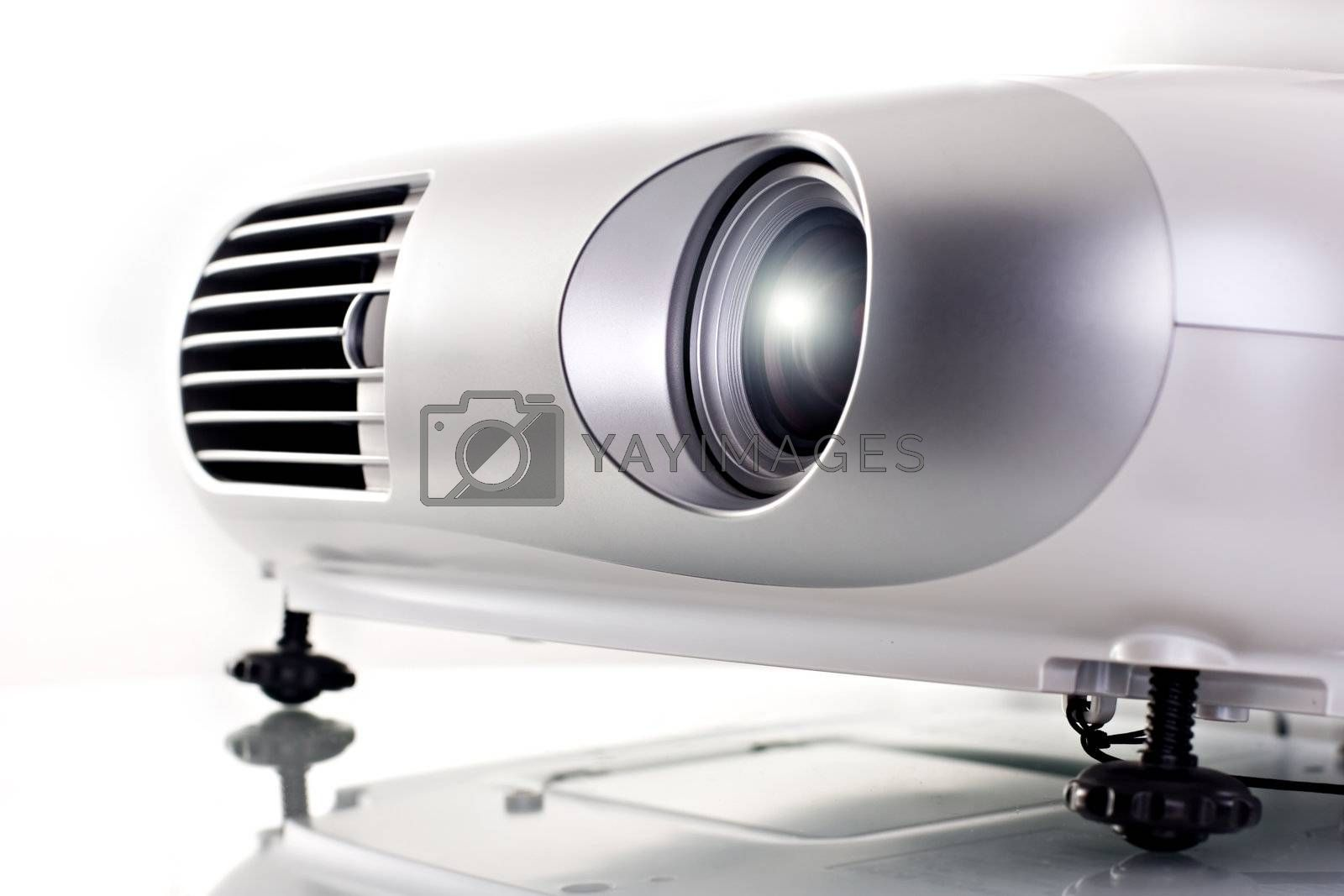 Video projector. High key shot on studio. White background.