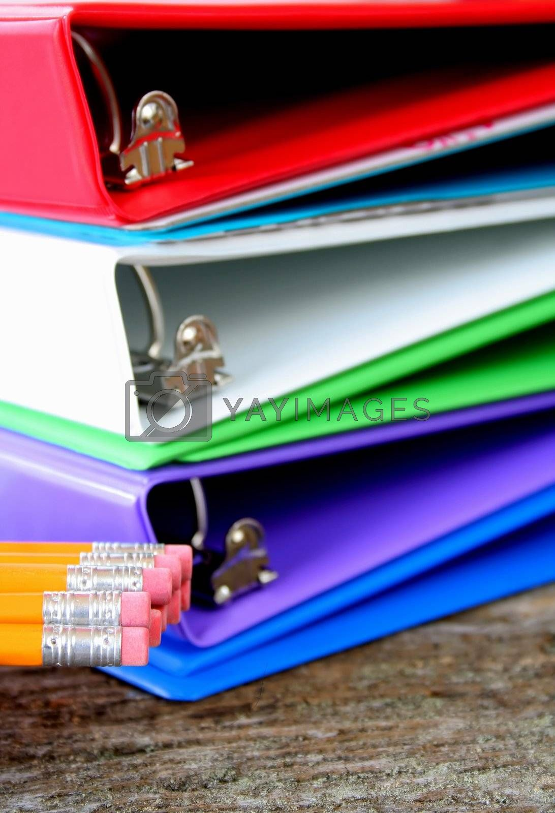 School or business supplies.  4 binders and pencils, used a shallow DOF with focus on the erasers.
