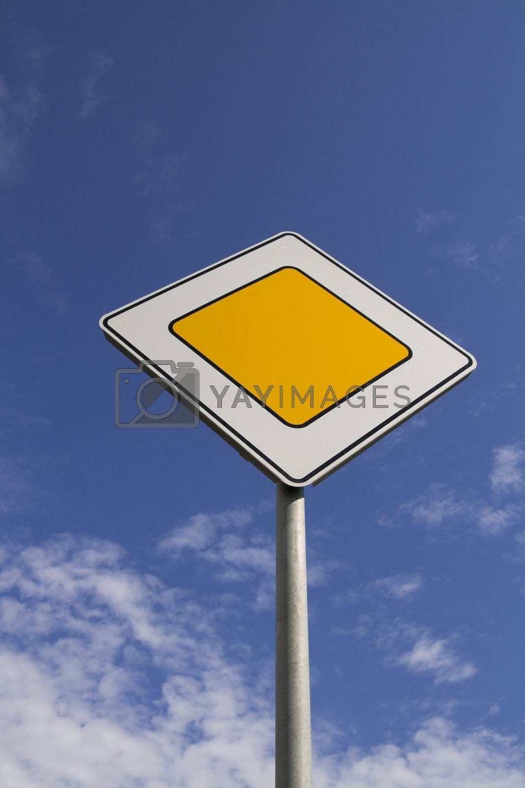 Traffic signs - the main road on blue sky background
