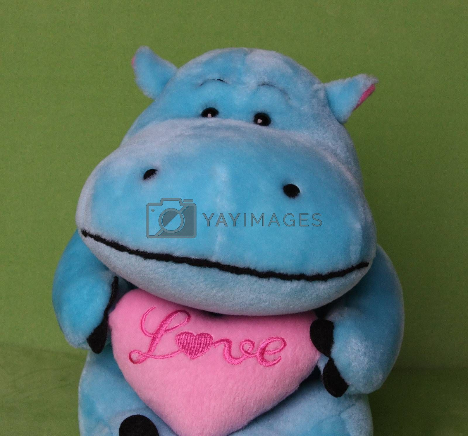 Soft toy hippo with a loving heart