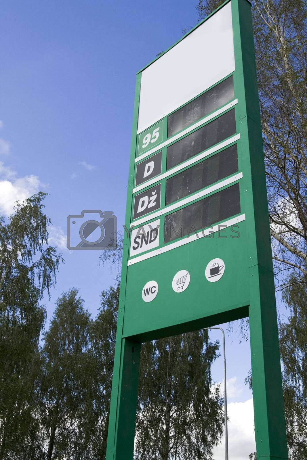 Royalty free image of Gasoline price sign by Nikonas