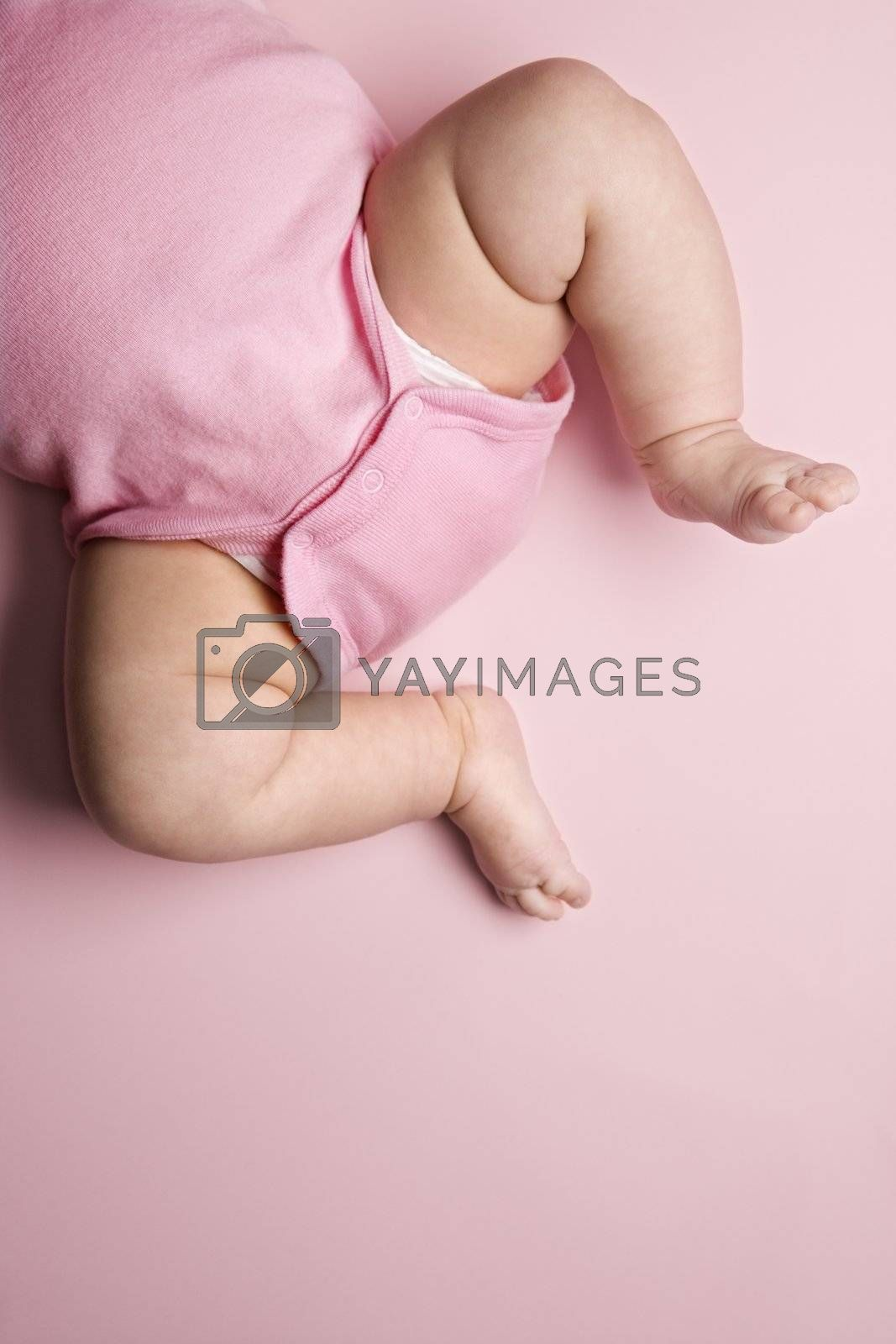 Close up of Asian babys chubby legs.