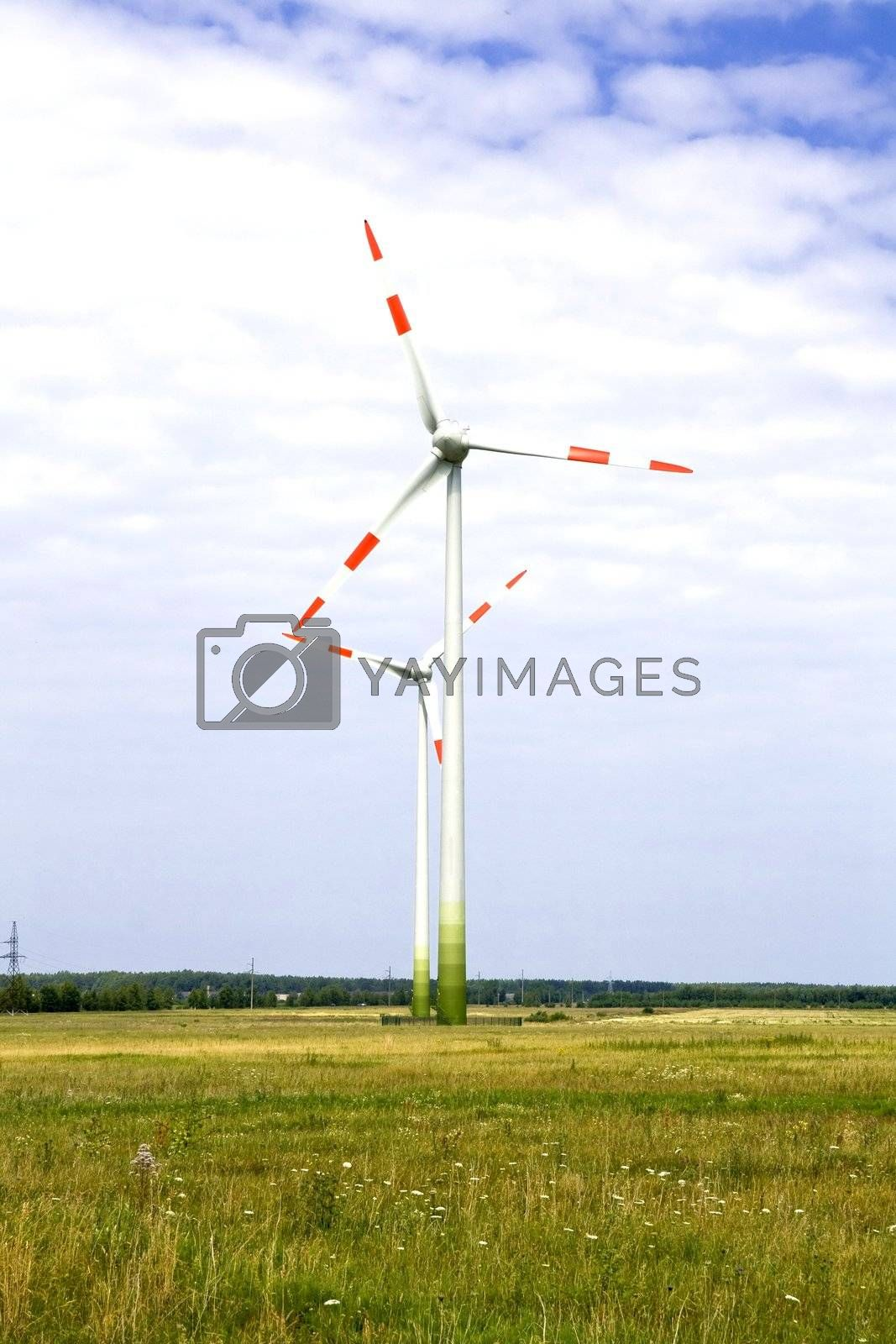 Energy concept - wind turbines in beautiful summer landscape