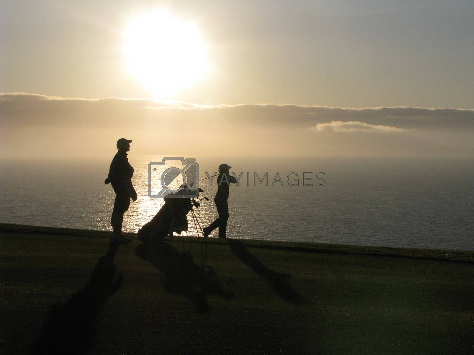 Royalty free image of Golfer and Caddy by ewilliamsdesign
