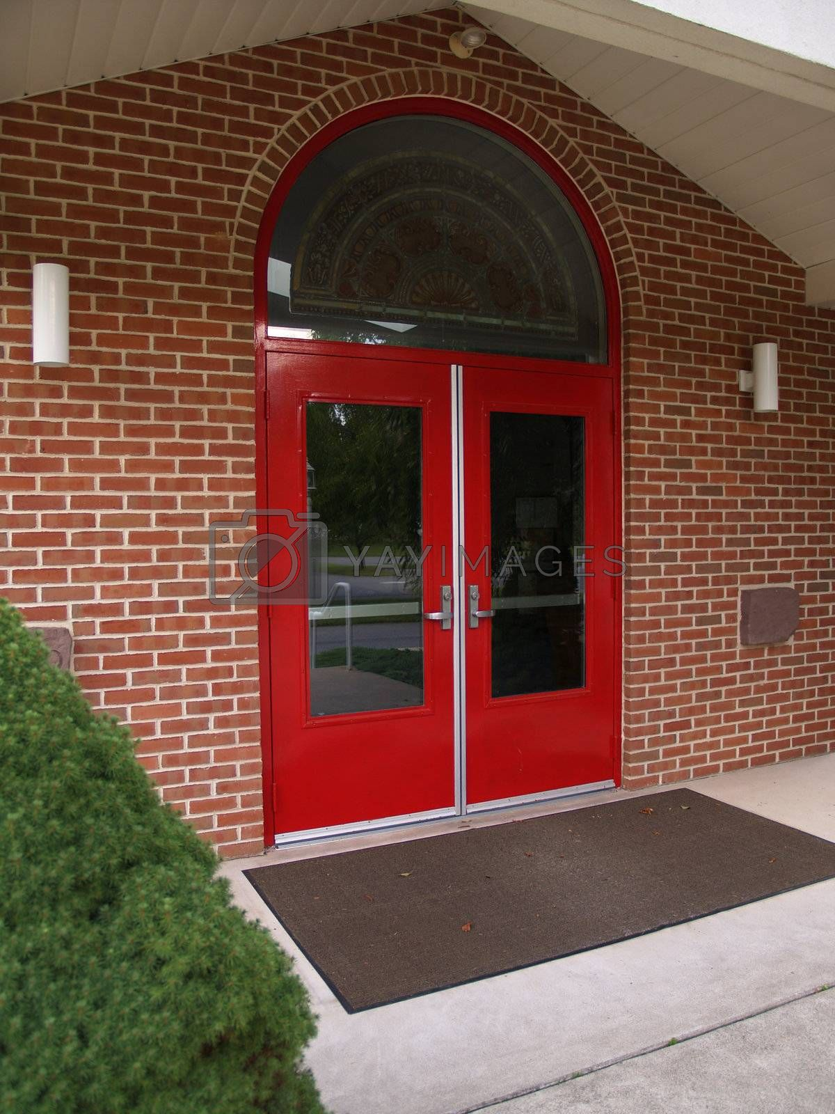 two red doors for a church entrance