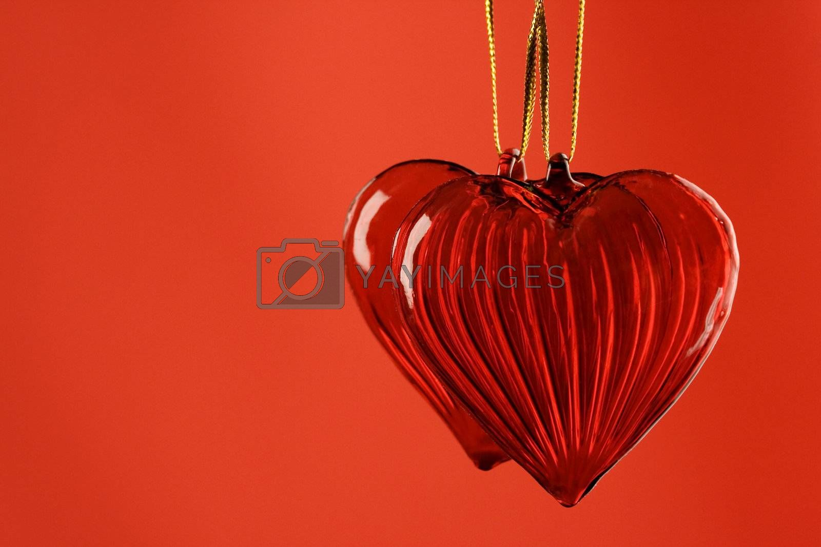 Two Valentine's hearts on red background