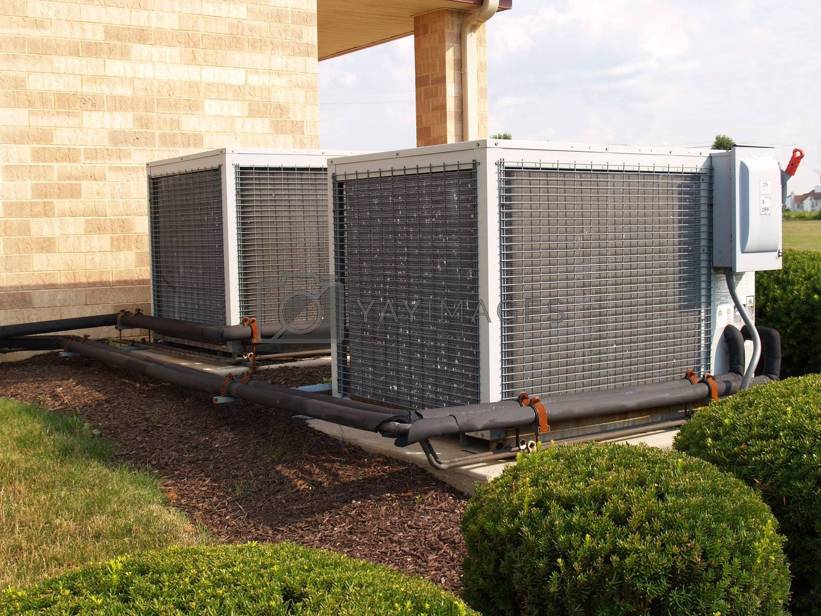 two heavy duty air conditioner units