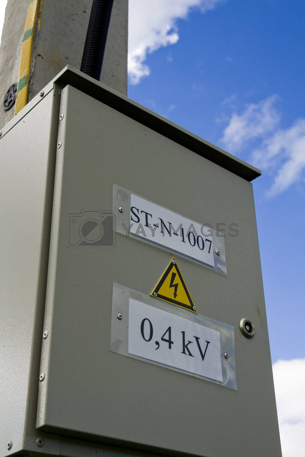 Fuse box with black/yellow sign warning for risk of electrocution