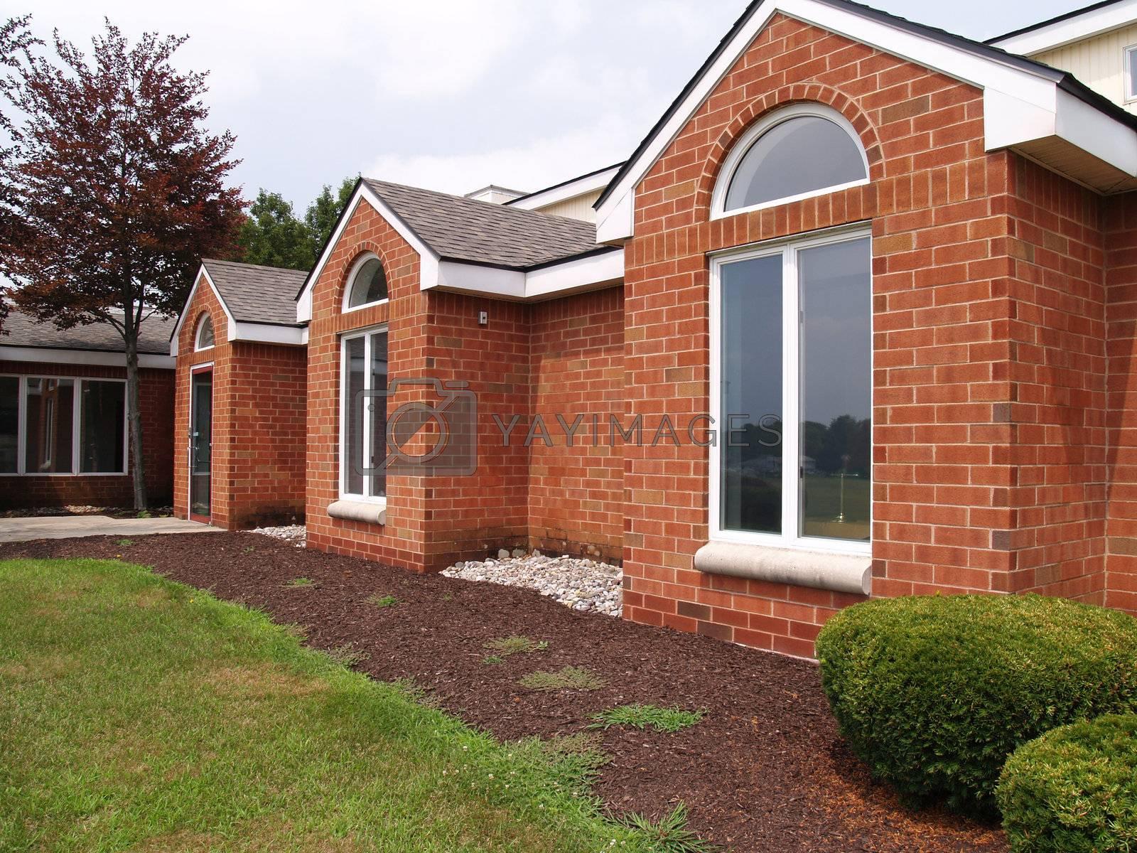 Royalty free image of modern windows on a brick building by cfarmer