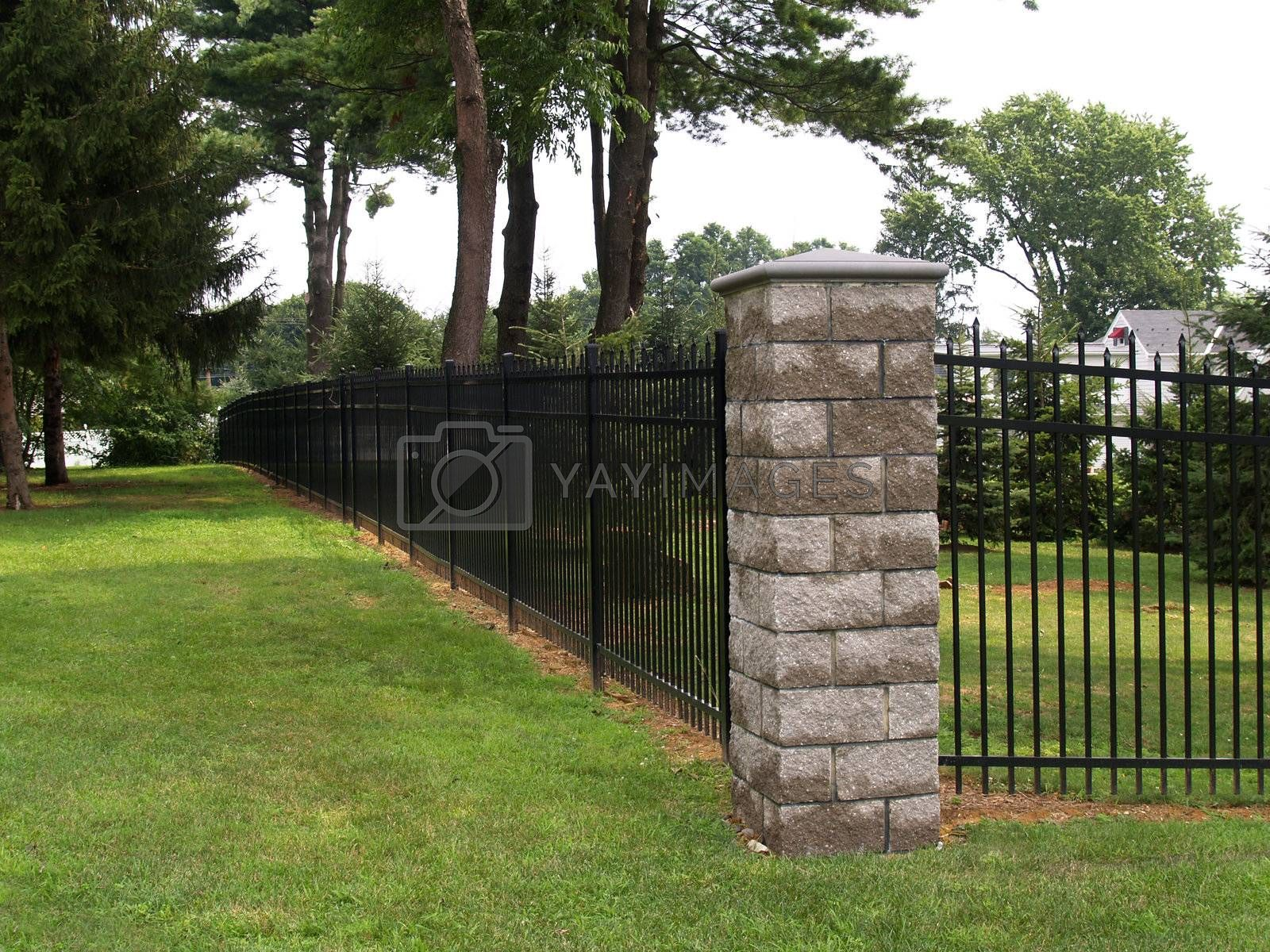 Royalty free image of tall black fence by cfarmer