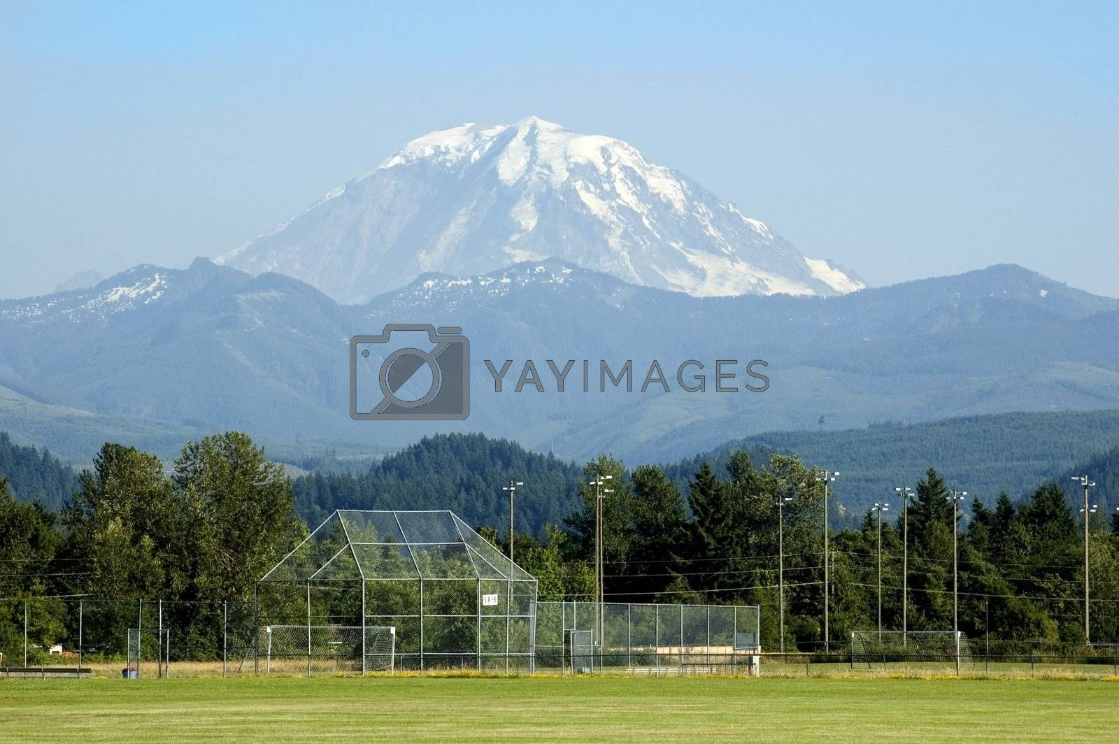 A majestic Mount Rainier towers over a soccer field in Washington State, USA.