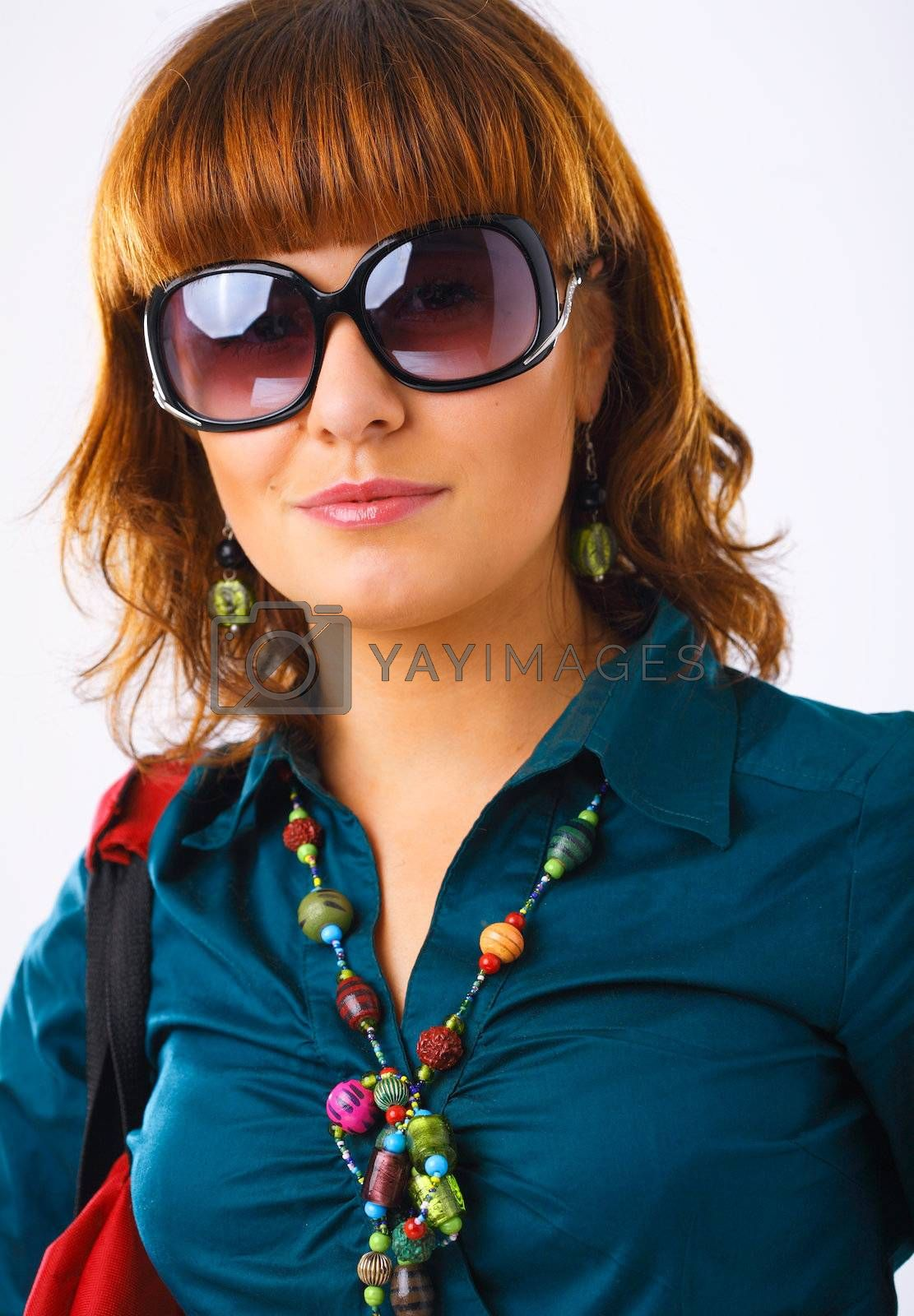 Beautiful young woman in sun glasses