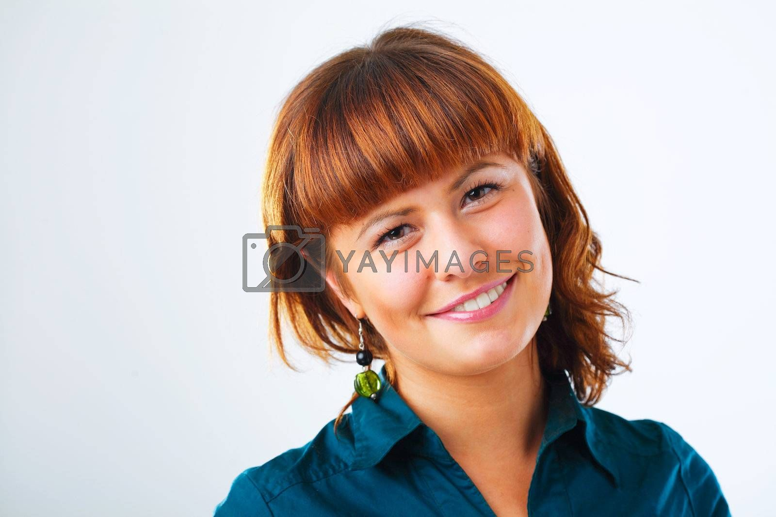 Happy young woman smiling with friendly look
