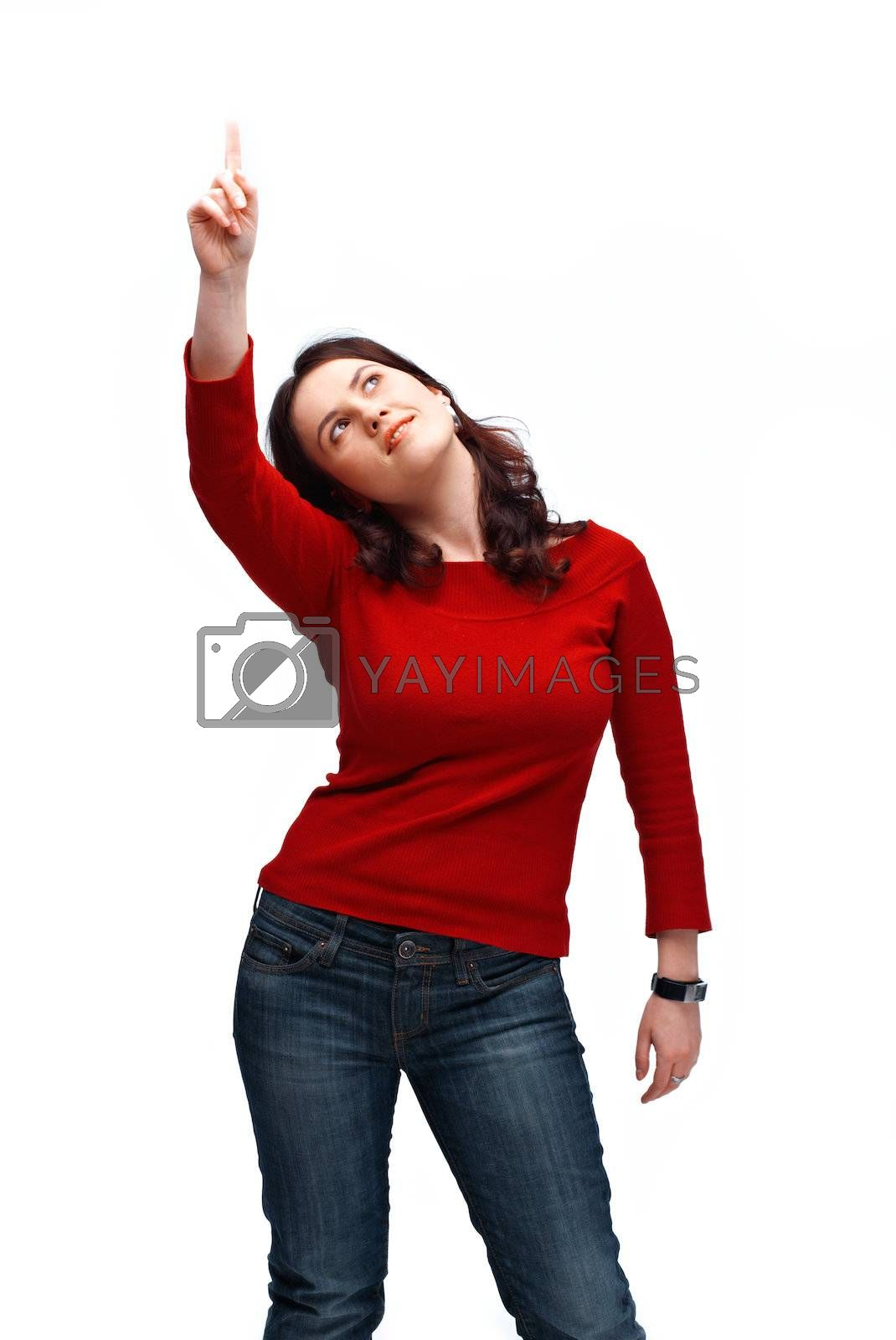 A portrait of a young girl pointing and looking at something up on white background