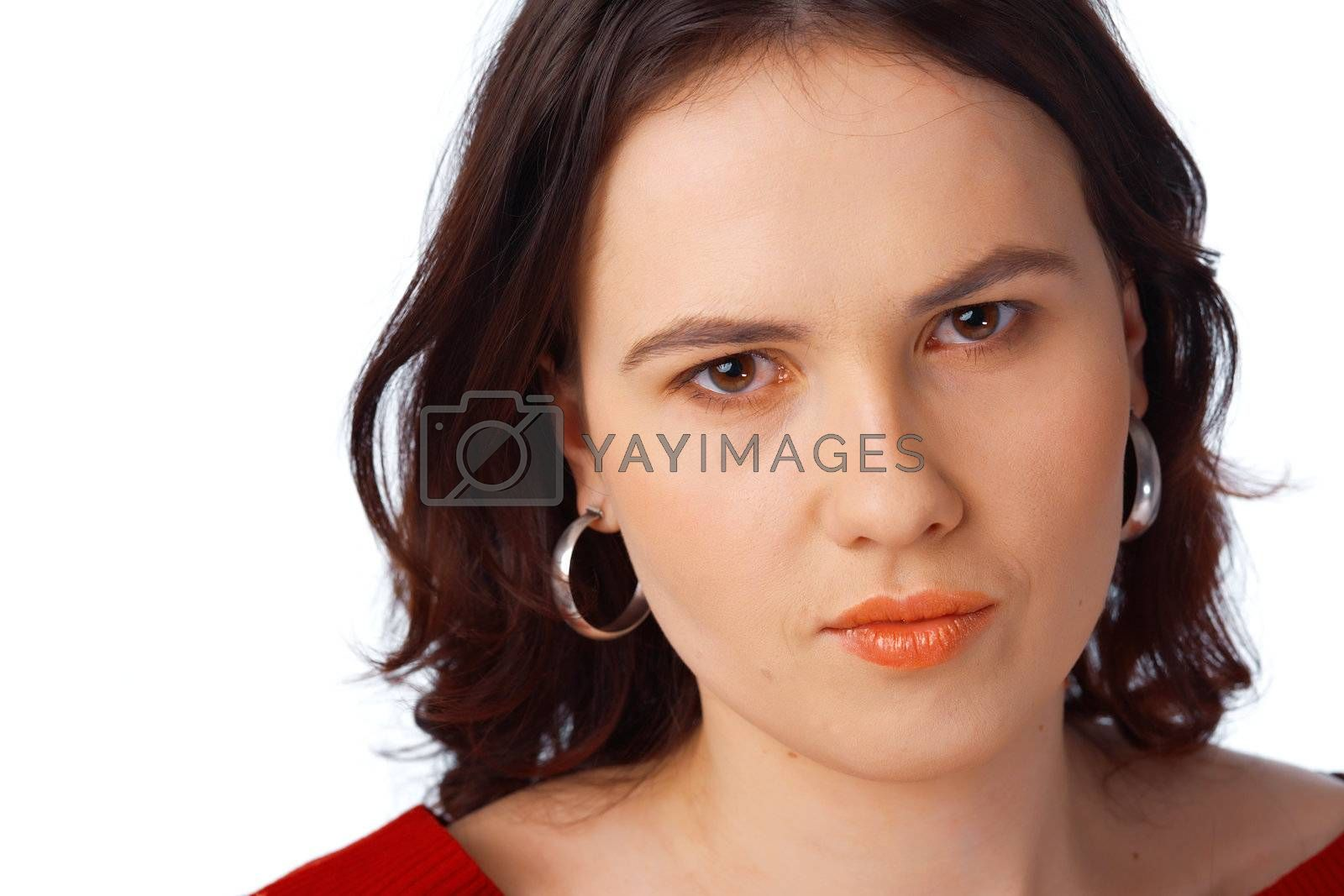 Portrait of a beautiful serious young female dressed in red jersey isolated against white background