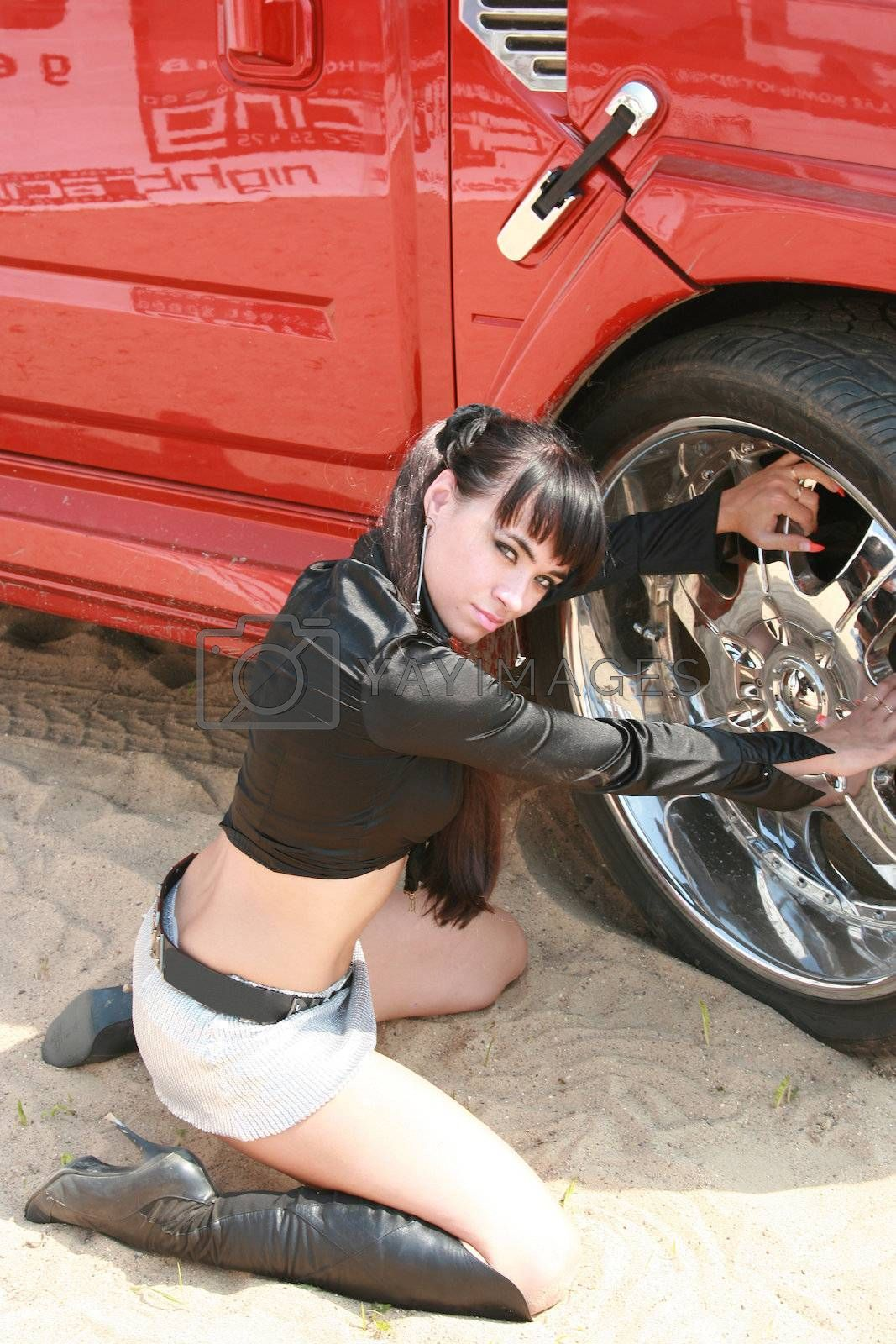 The glamour girl poses at the smart car