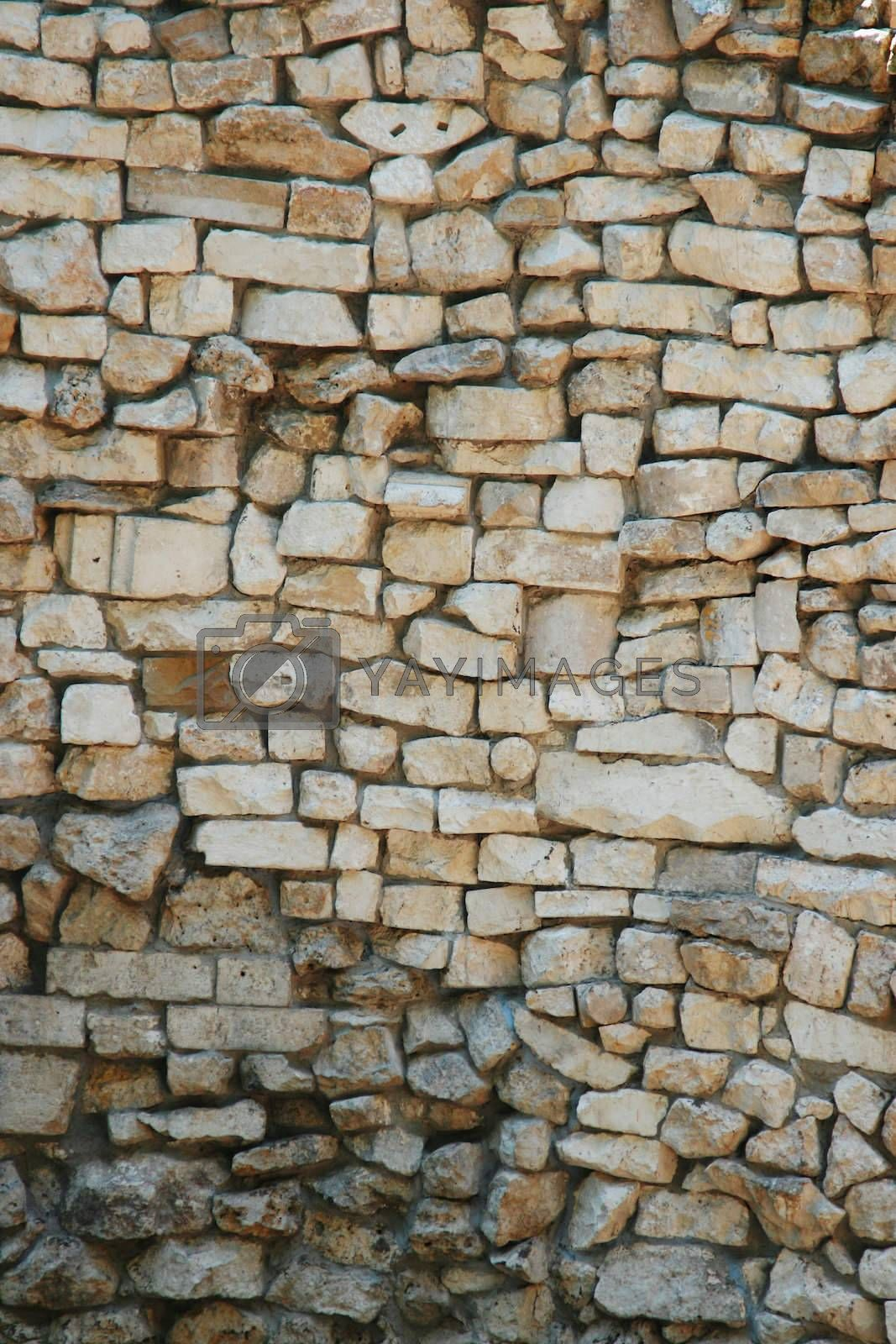 Ancient wall from a stone and a brick