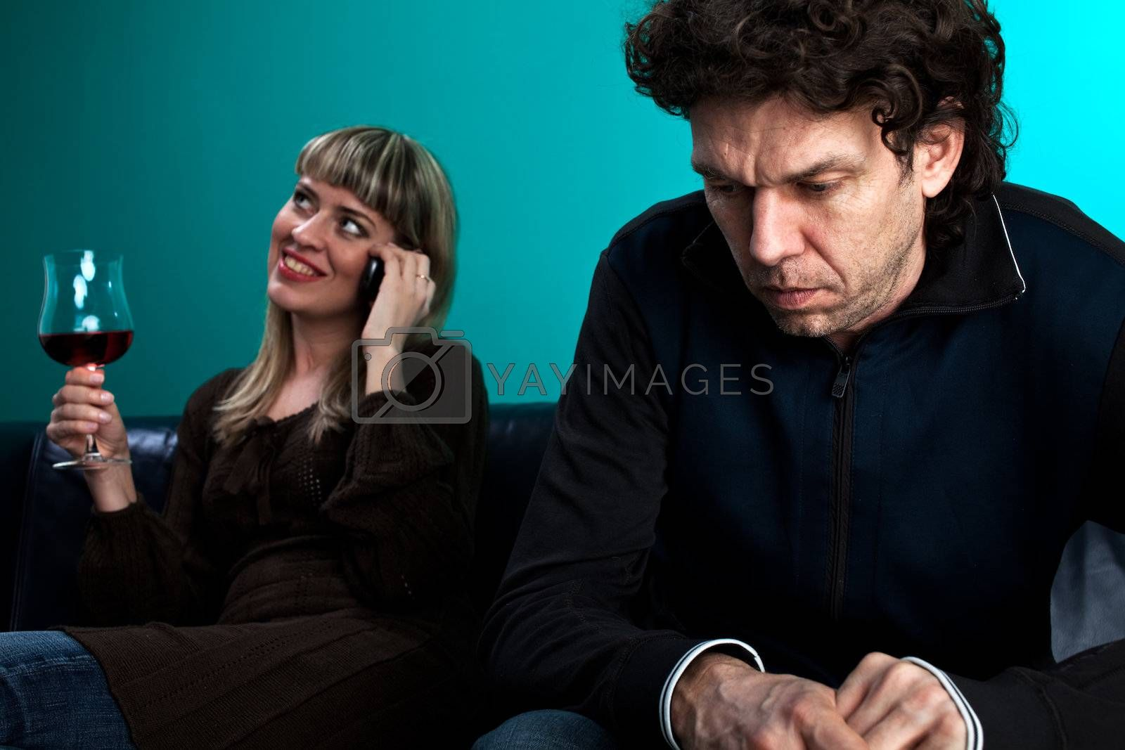 woman talking on the phone and a frustrated man