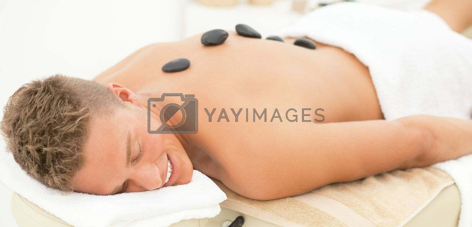 Young blond handsome man enjoying spa treatment