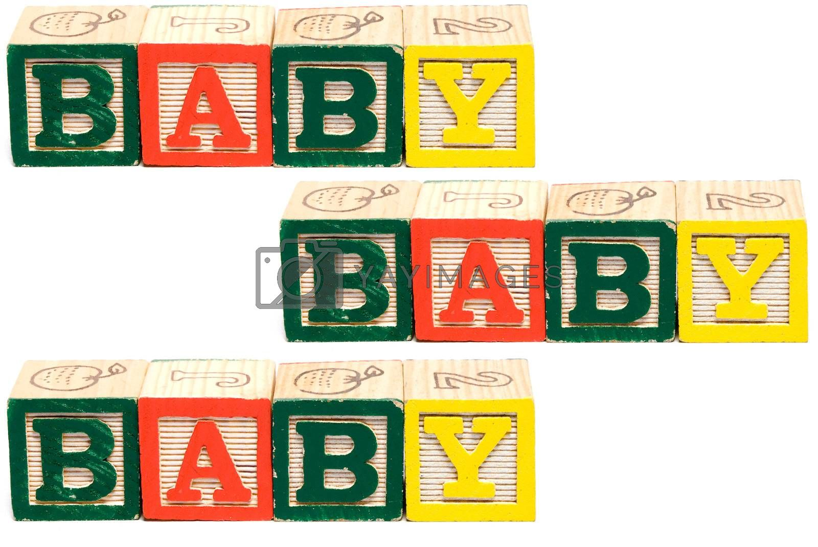 Three groups of baby blocks spelling the word baby