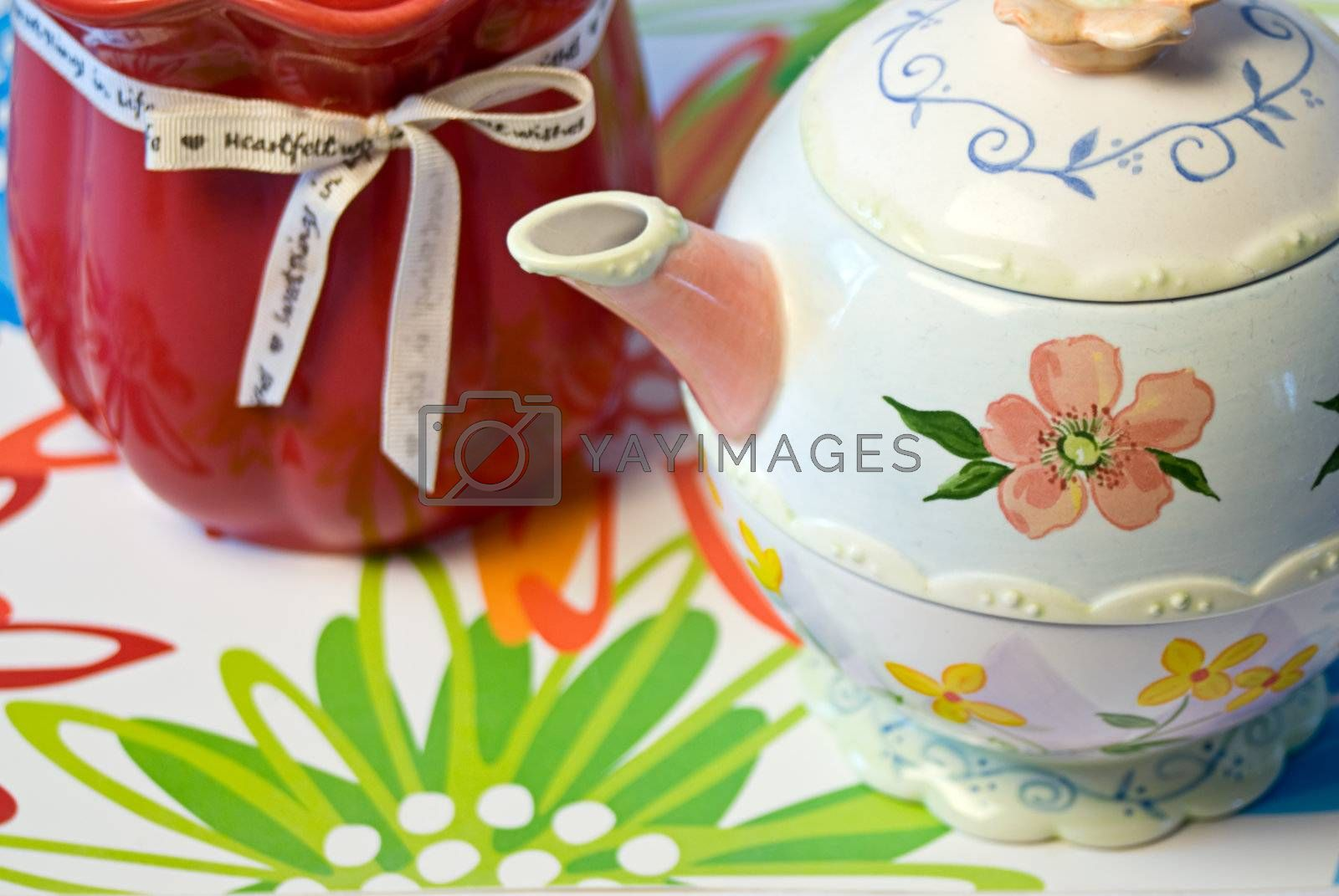 Mothers Day candle and teapot on a floral placemat