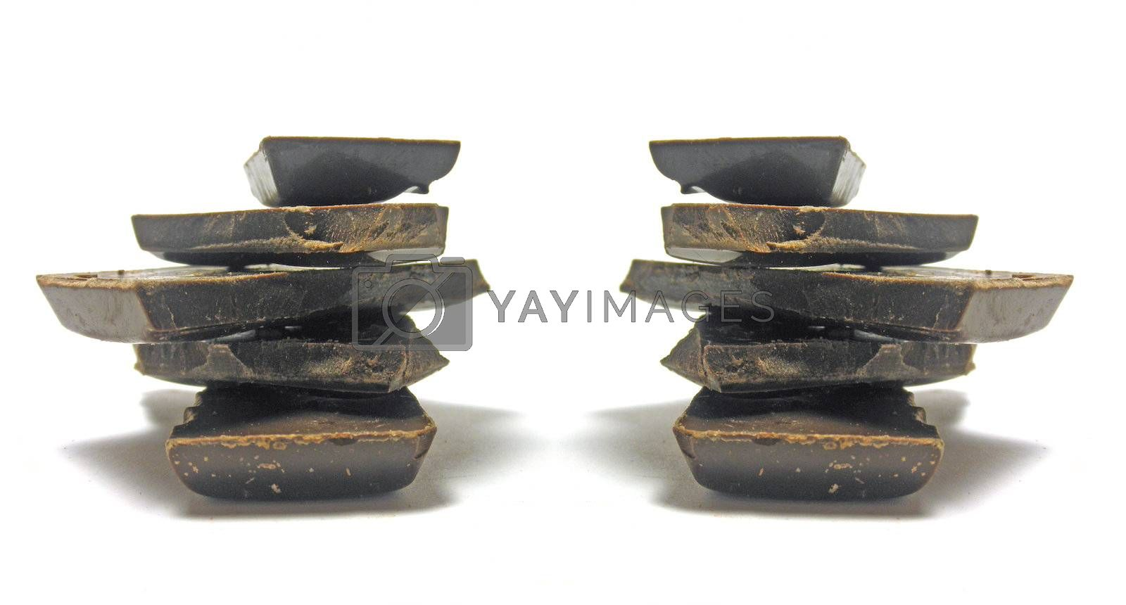 Beautiful chocolate pieces isoalted on white background