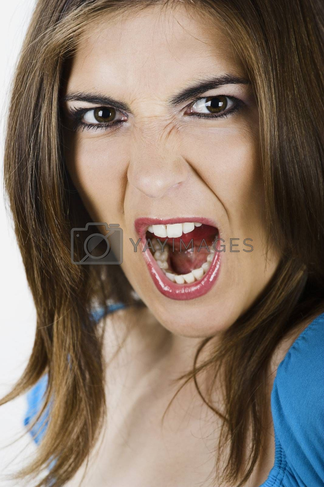 Close-up portrait of a beautiful young woman yelling
