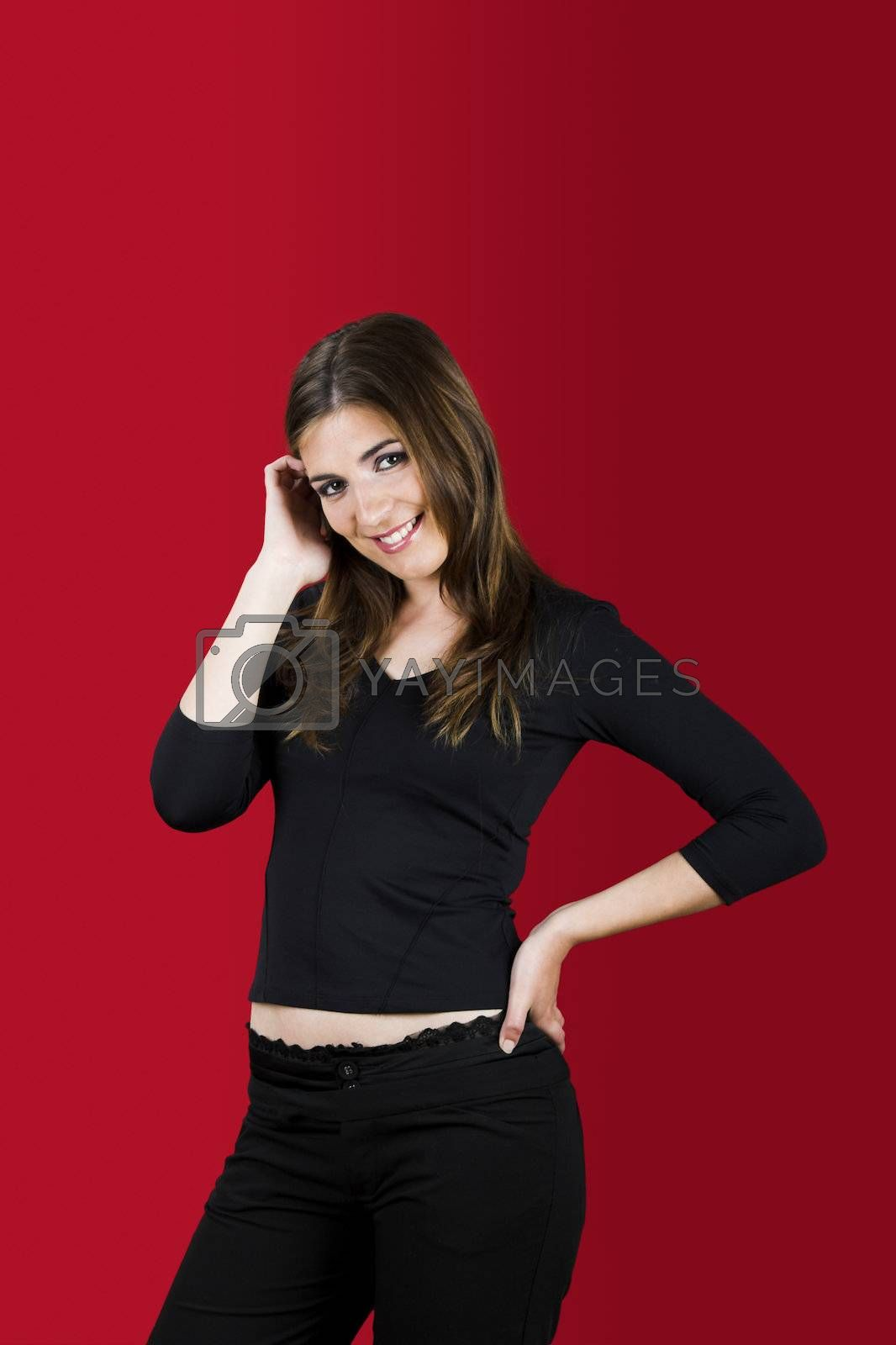Portrait of a beautiful woman on a red background