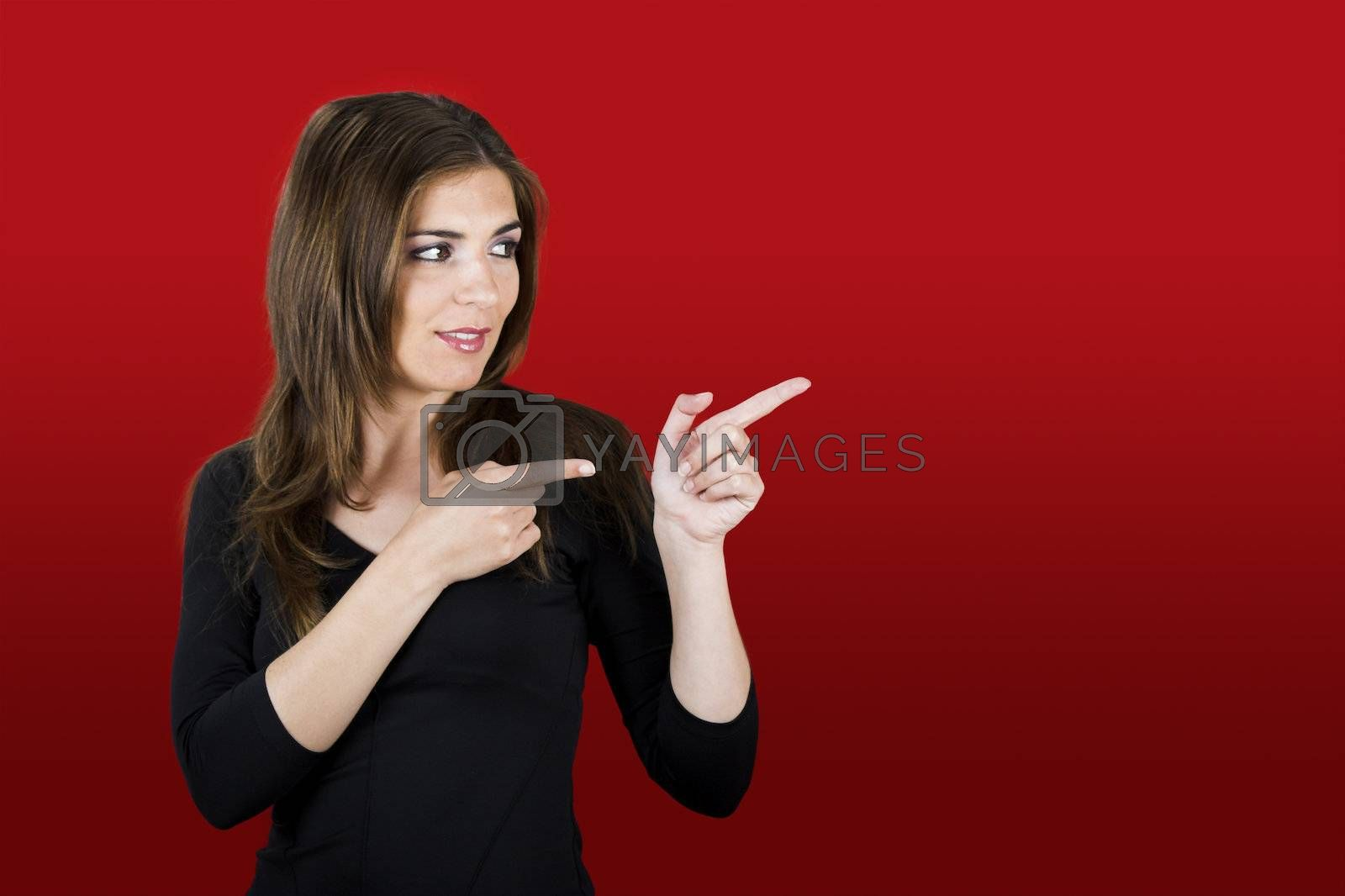 Beautiful woman in red showing a direction with her hands