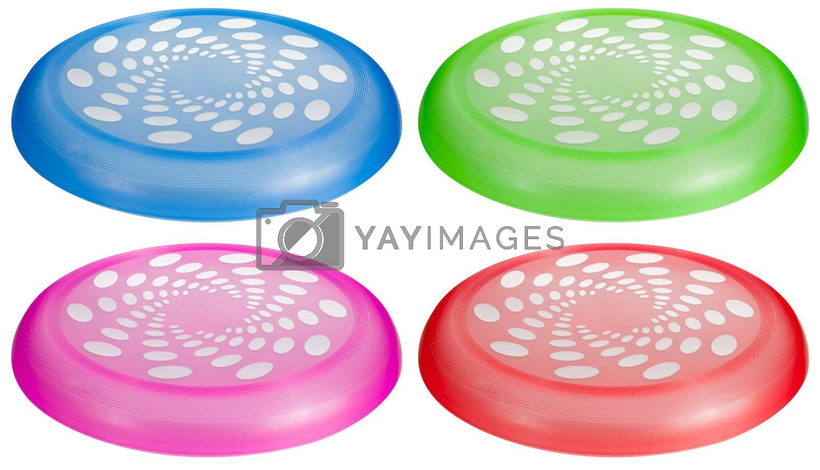 A set of colorful flying toy discs isolated on white.