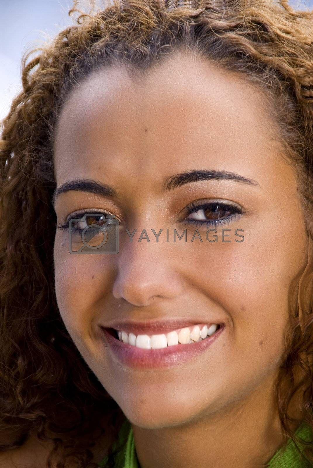 A beautiful African American Woman smiling wide