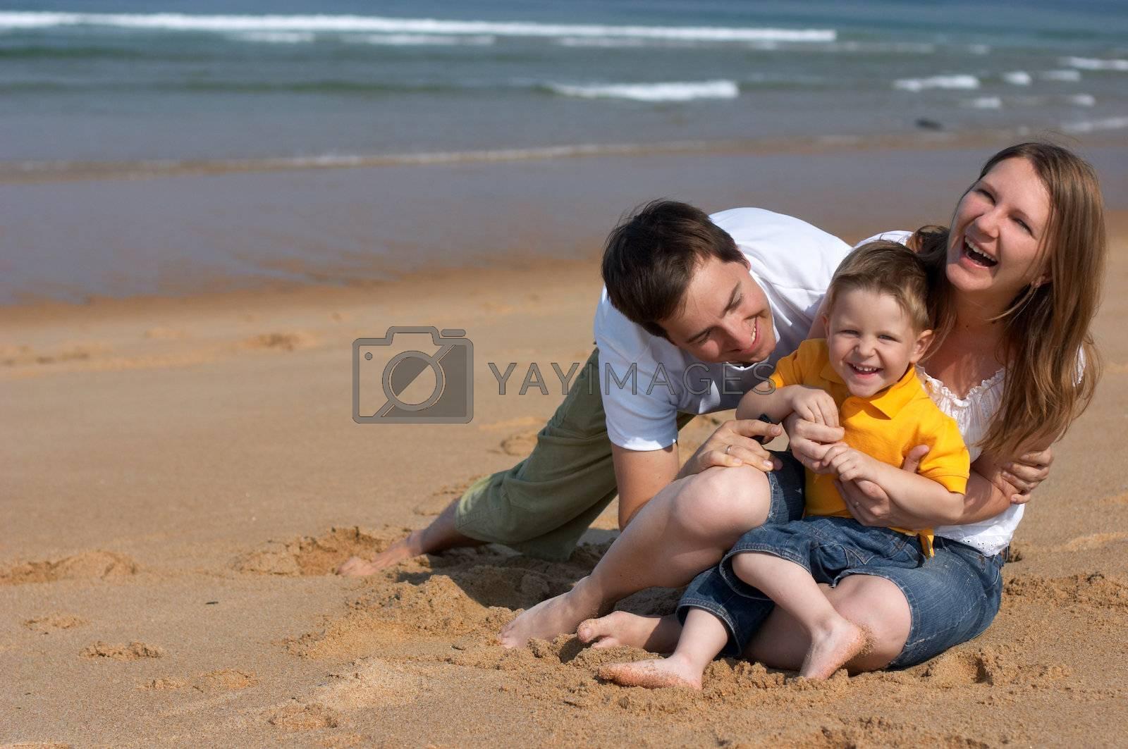 Family fun at the beach by shalamov