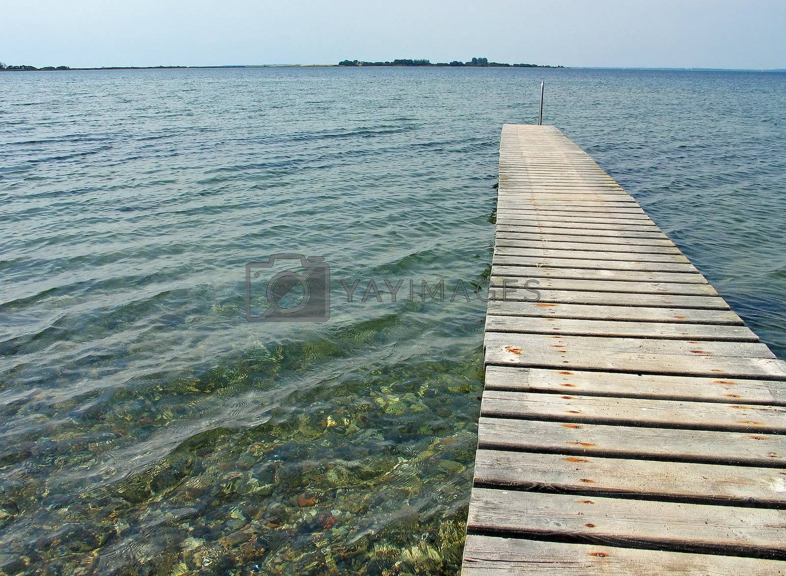 Small old wooden pier jetty Funen Denmark