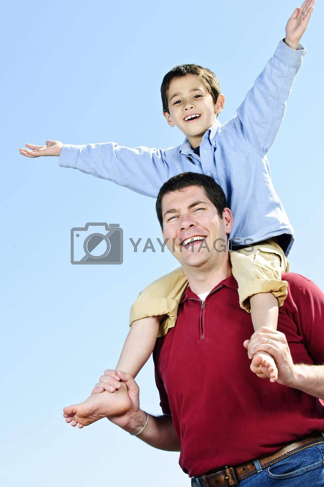 Portrait of father giving shoulder ride to son