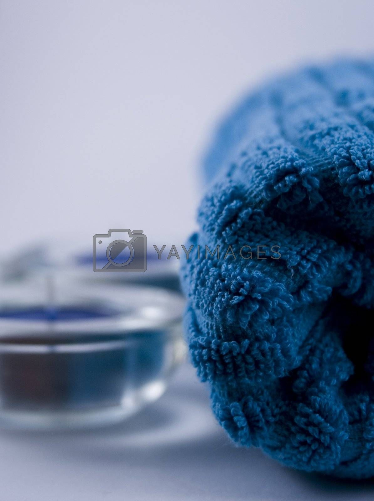 blue towel and two blue candles
