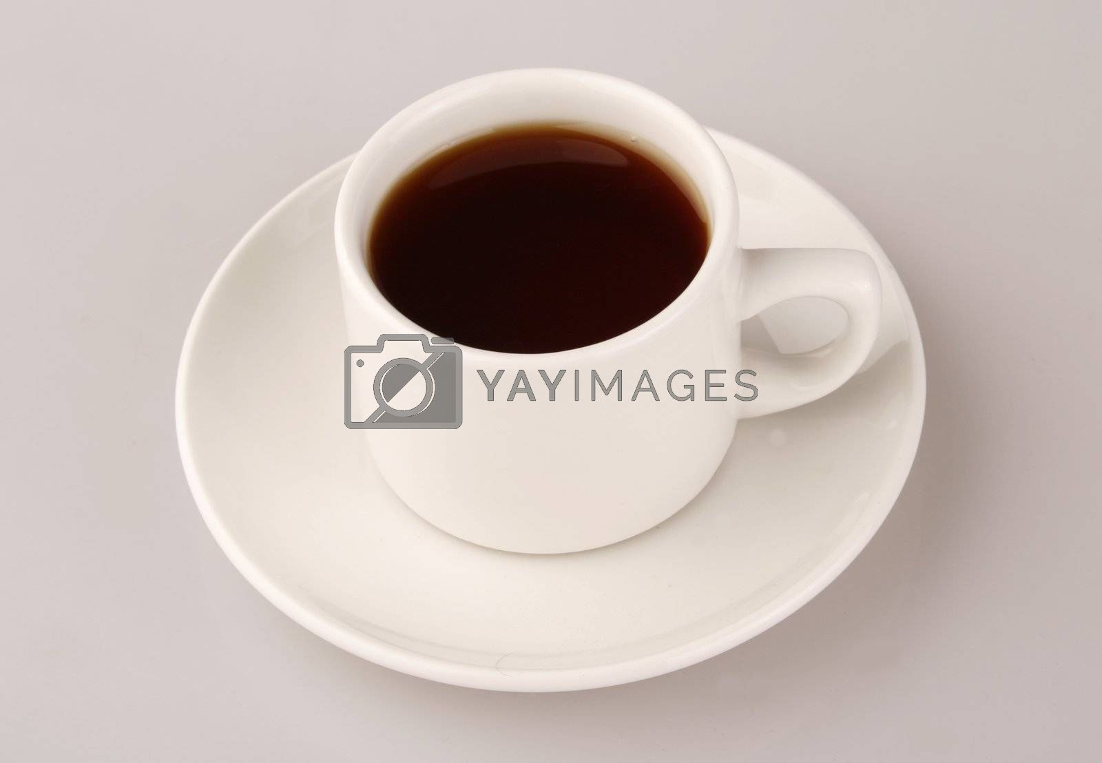 tea in white cup over background