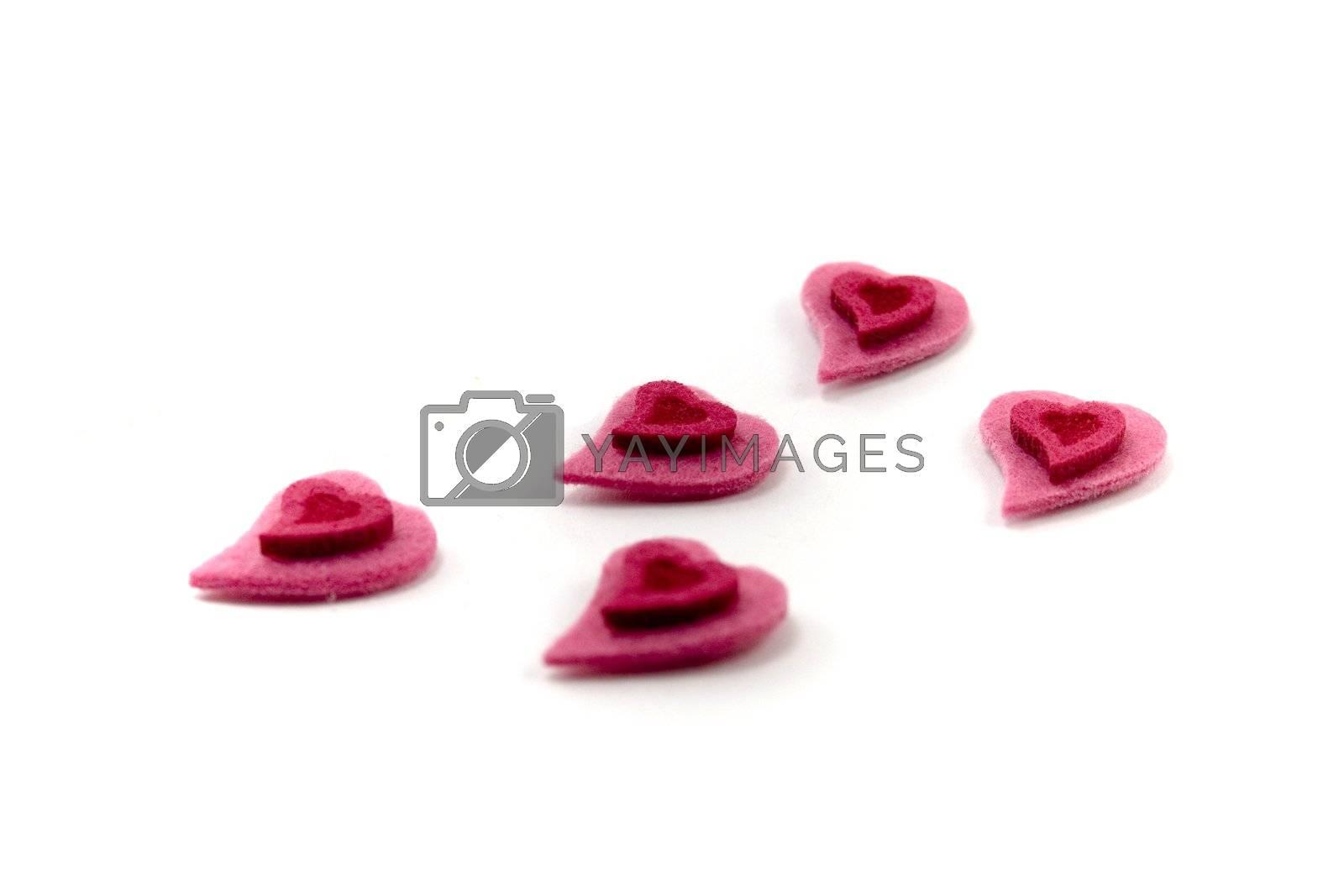 five Valentine's hearts over white background