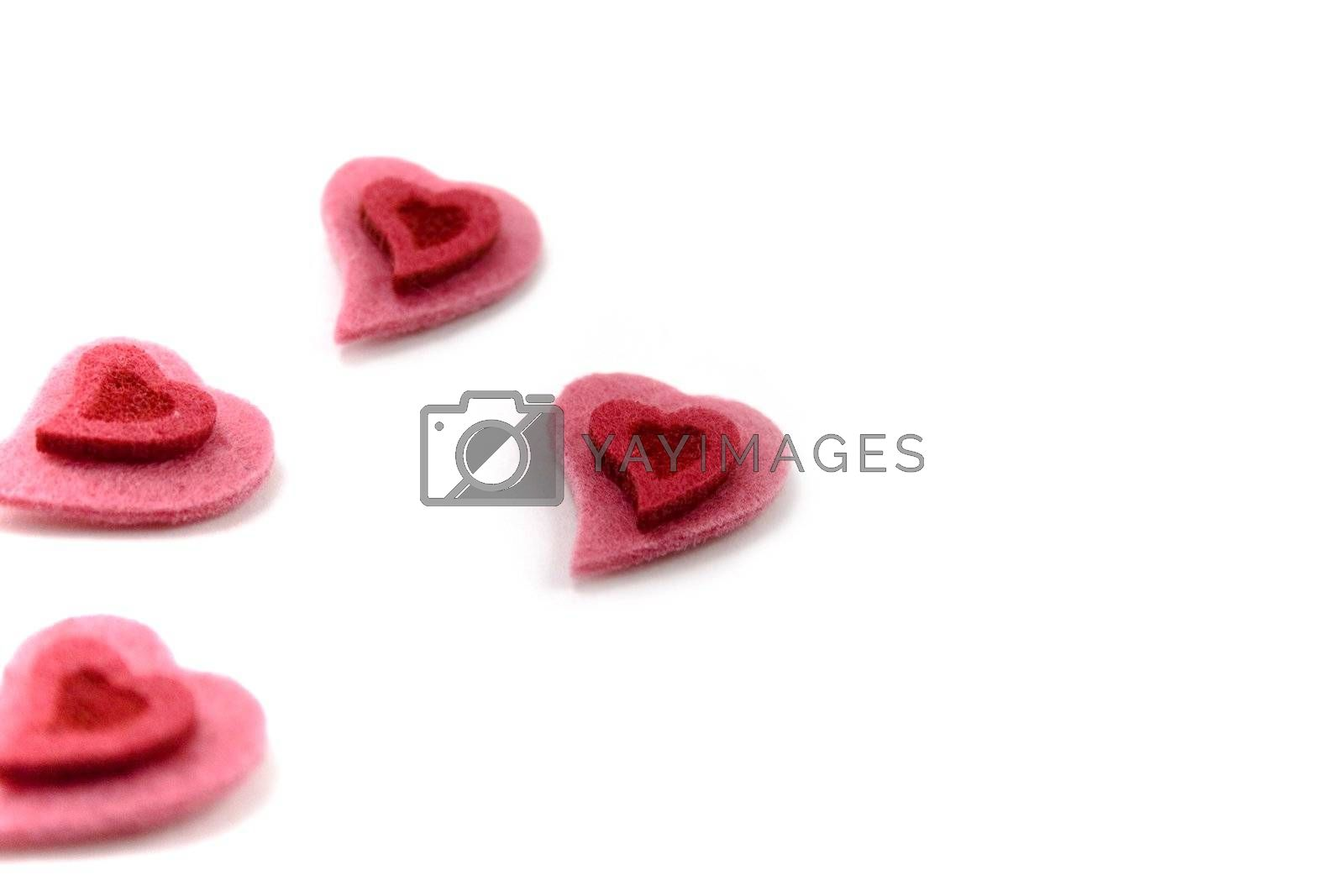 four Valentine's hearts over white background