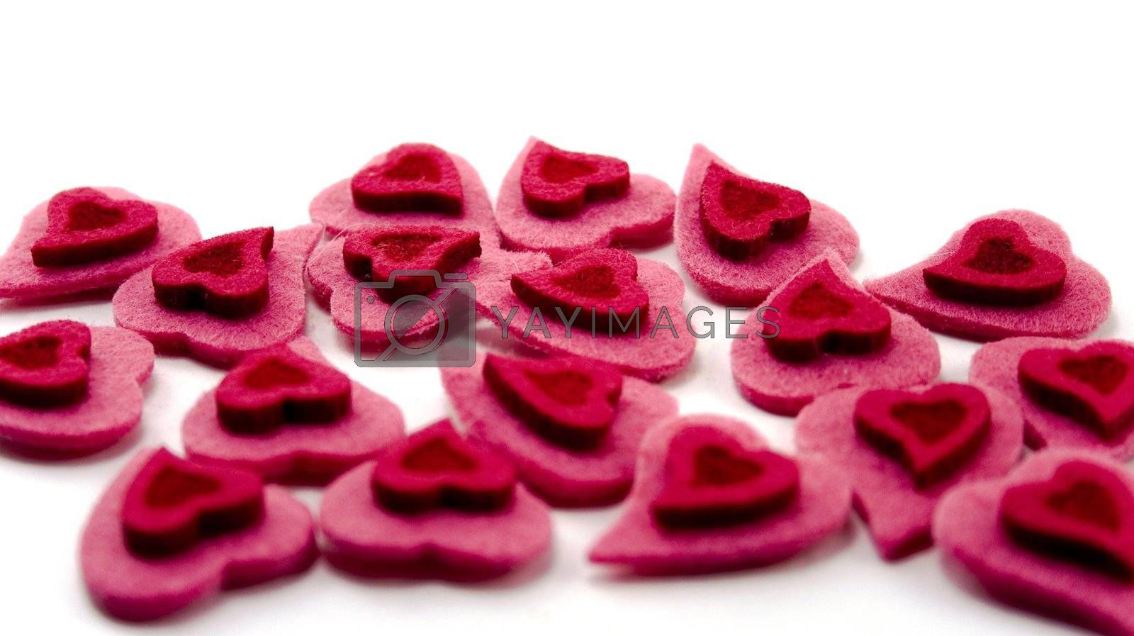 a lot of Valentine's hearts over white background