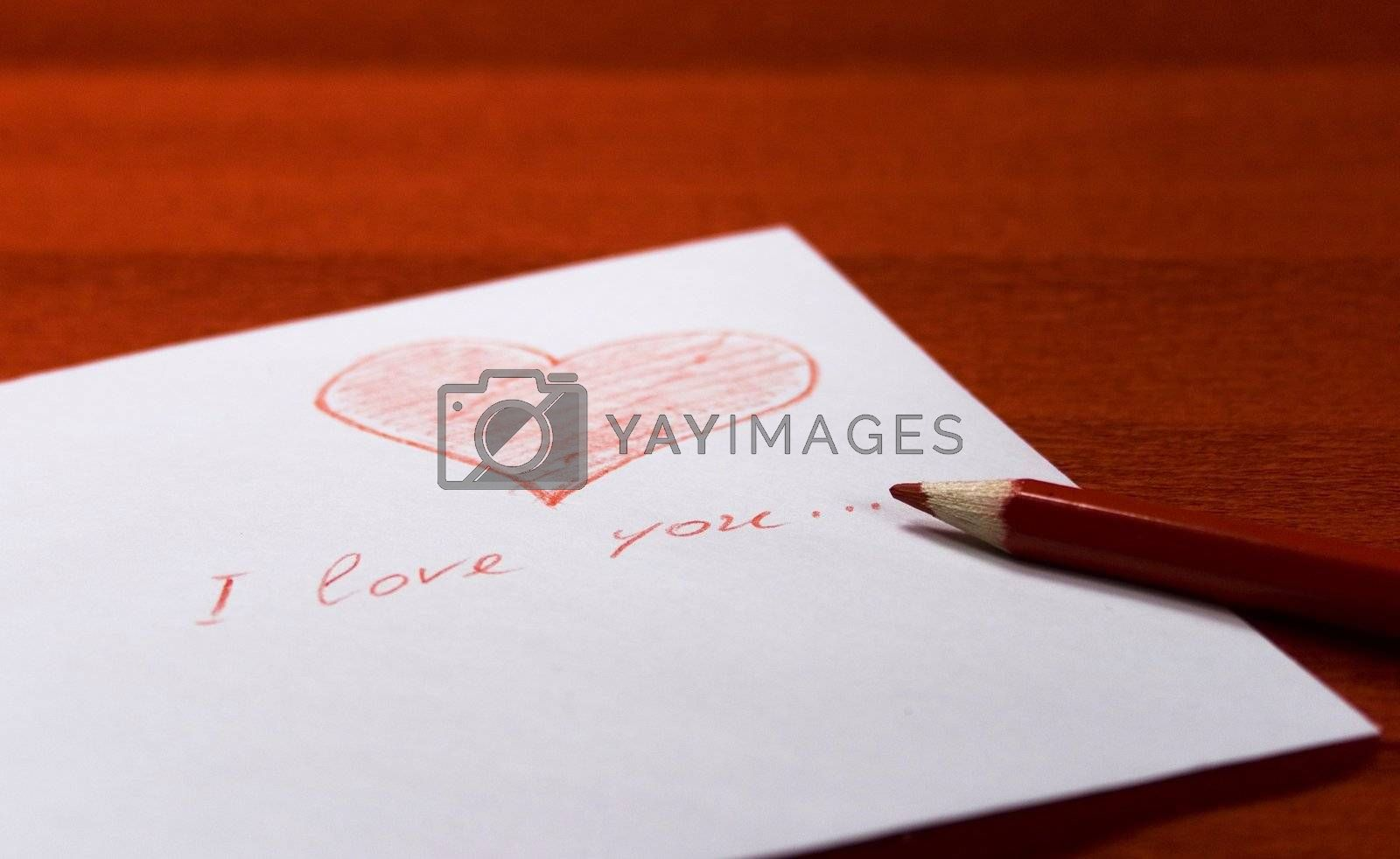 white envelope with red heart and pencil on red background