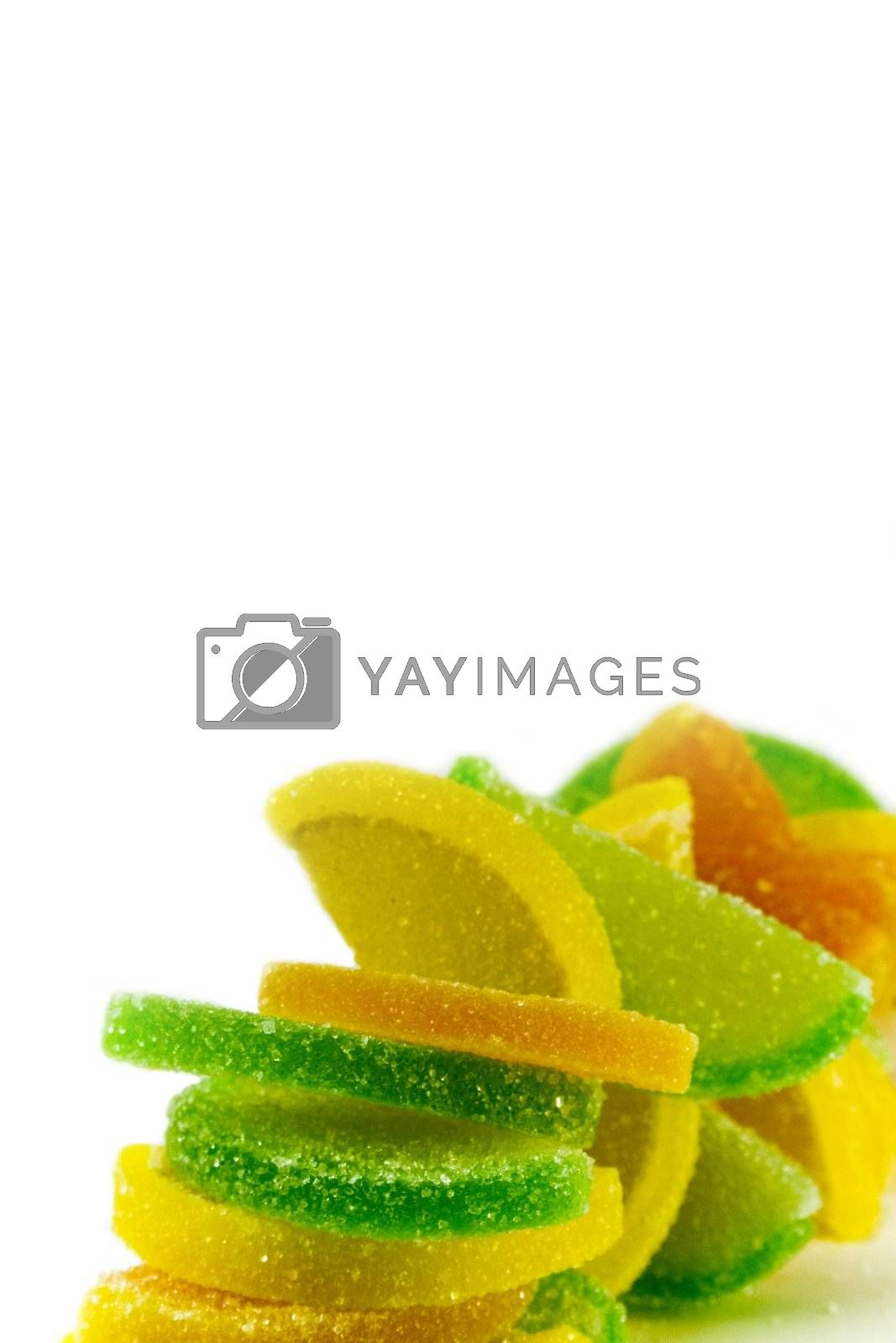 colourfu fruit candies over white background